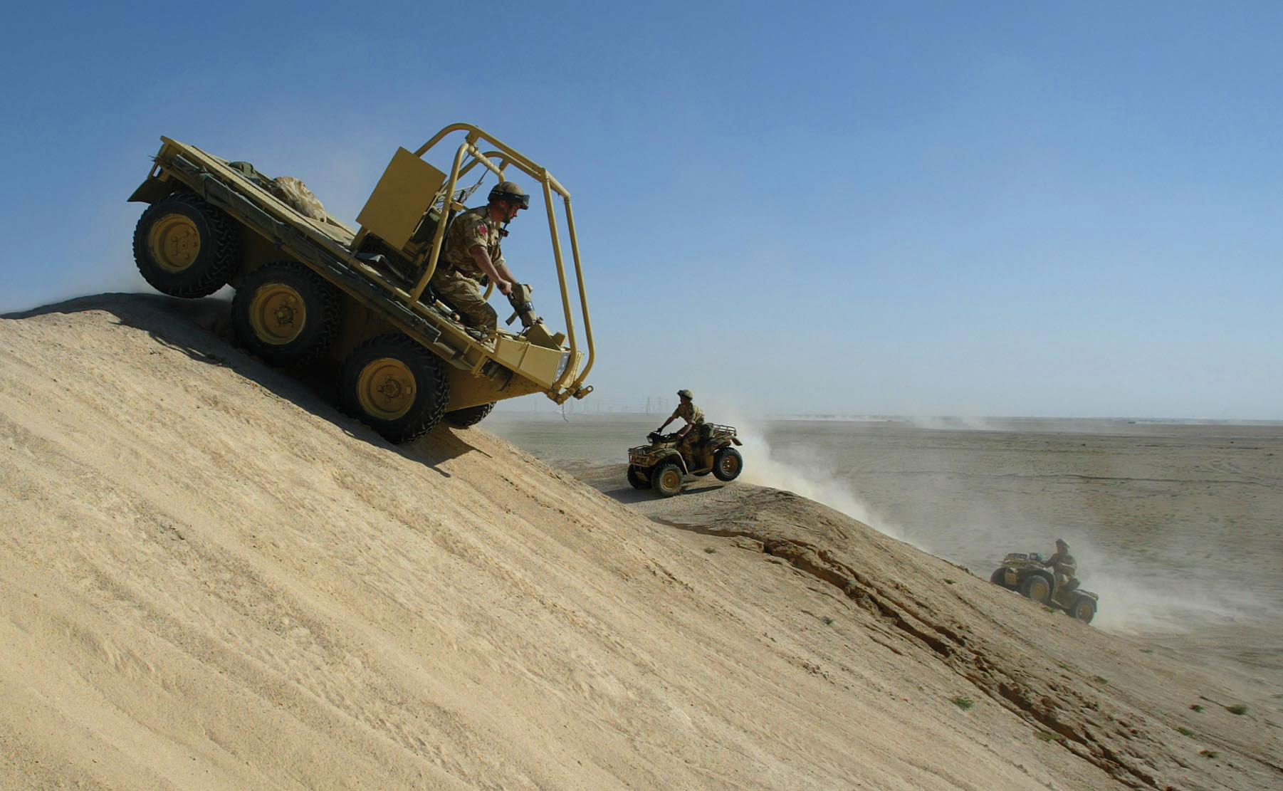 Soldiers from the 1st Battalion The Parachute Regiment practise driving all terrain vehicles in the Kuwaiti desert.