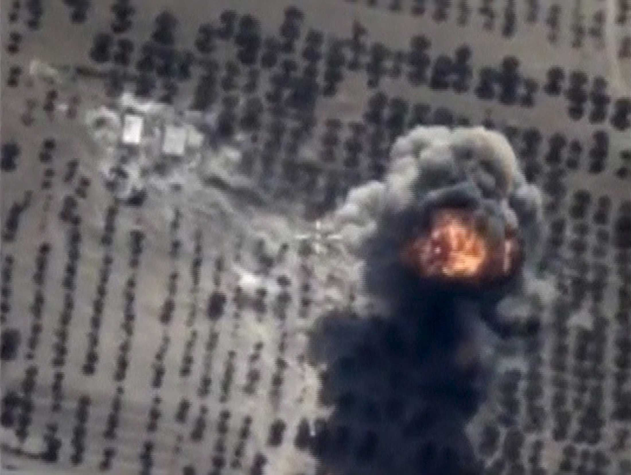 Footage released by Russia's Defence Ministry shows what Russia says is an explosion after airstrikes carried out by the Russian air force on an Islamic State armored vehicles revetment and fuel depot in Idlib province, Syria, on Oct.15, 2015.