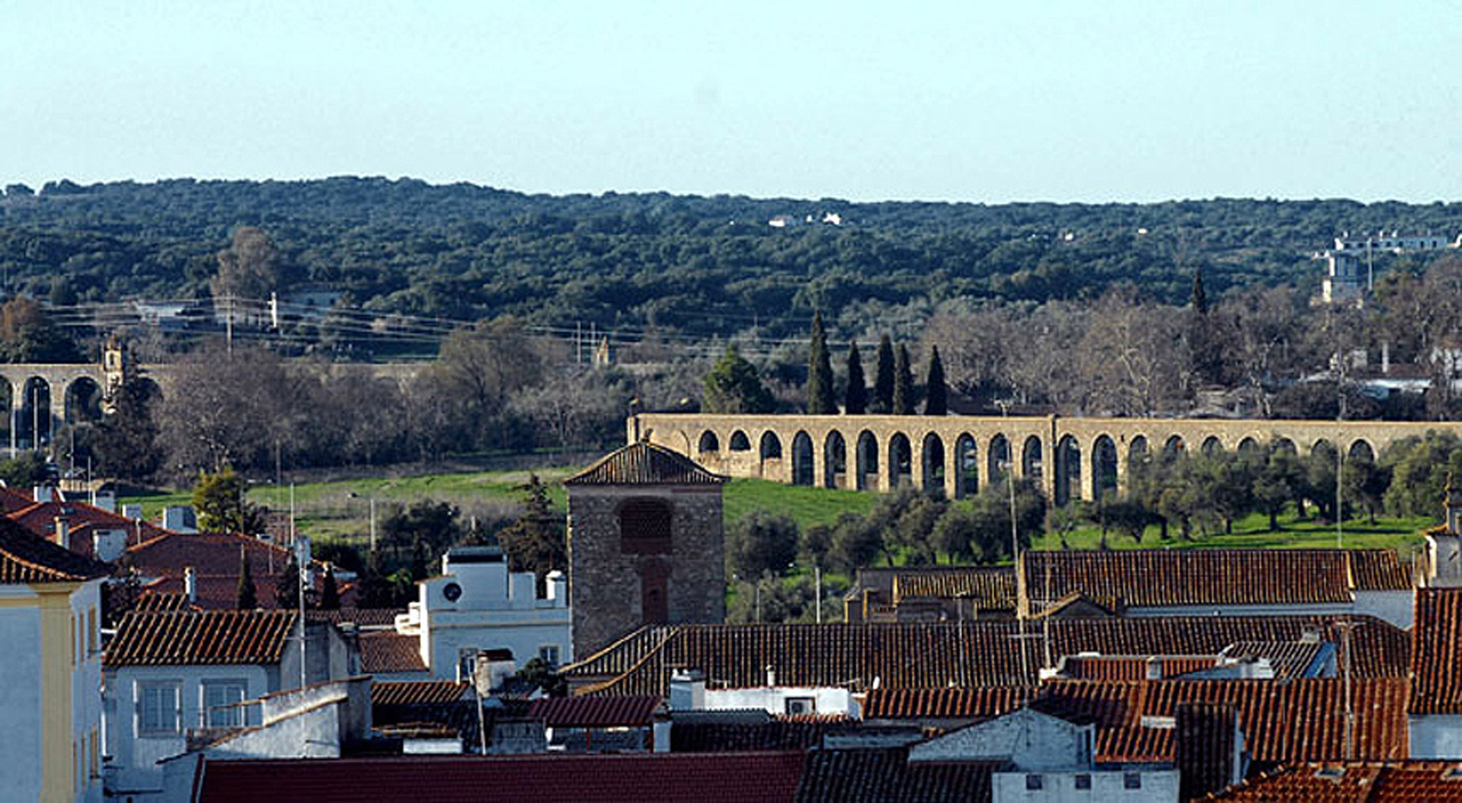 Portugal, Água da                               Prata Aqueduct: Laborious effort is needed to preserve the Água da Prata Aqueduct while allowing it to keep functioning for the irrigation of parks and gardens.