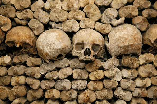 Skulls and bones are stacked at the Catacombs of Paris on October 14, 2014