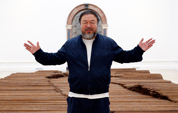 Ai Weiwei stands with his sculpture Straight as he previews works from his landmark art exhibition on Sept. 15, 2015, in London