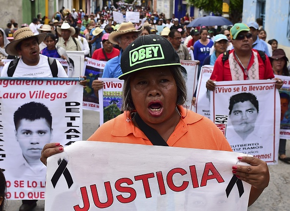 Relatives and friends of the 43 missing students from Ayotzinapa take part in a demonstration in Iguala, Guerrero State, Mexico, on September 27, 2015, to commemorate the first anniversary of their disappearance