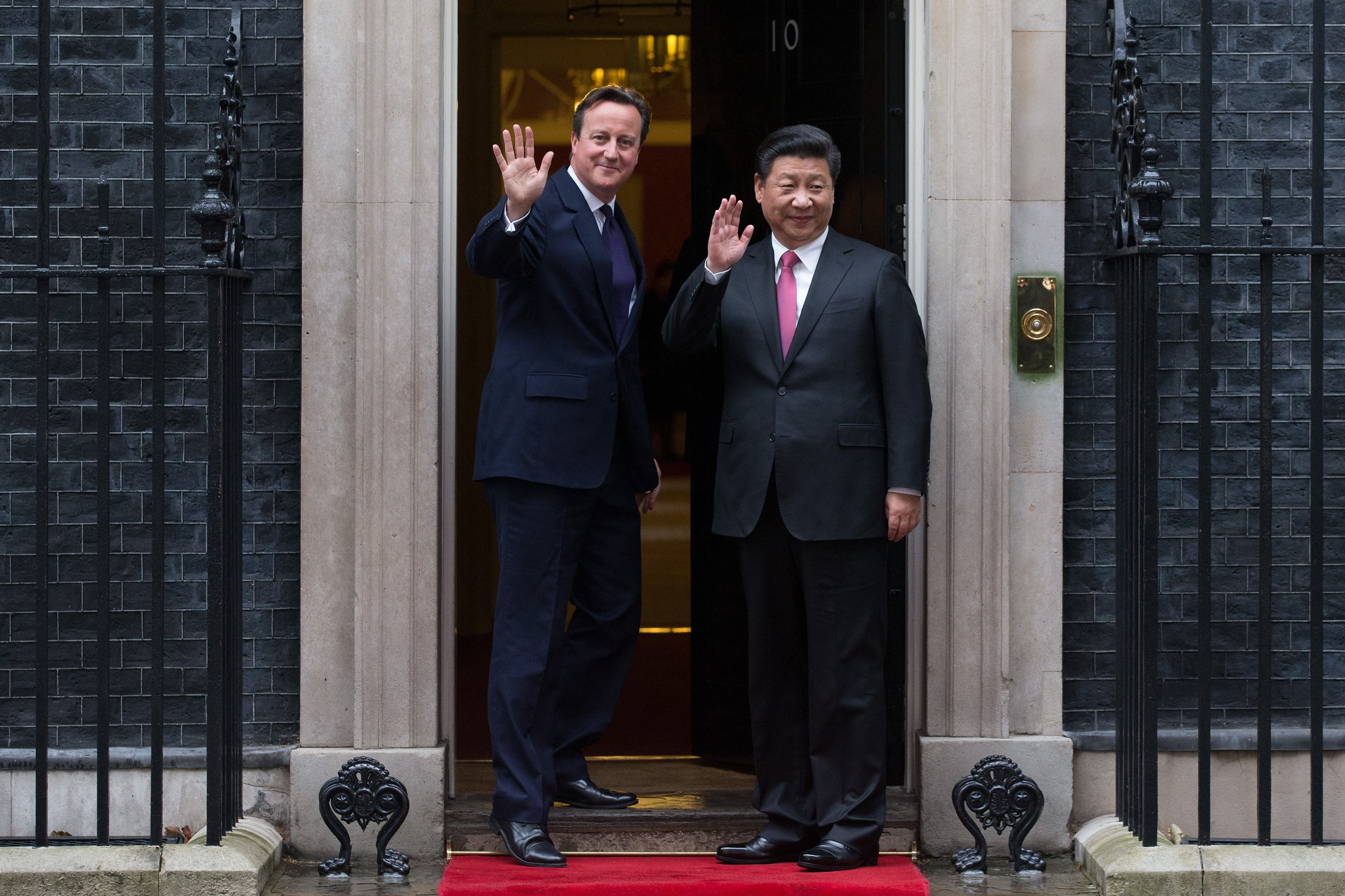 David Cameron greets Xi Jinping as he arrives in Downing Street on Oct. 21, 2015 in London.