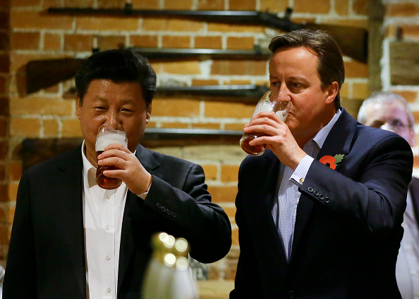 China's President Xi Jinping and Britain's Prime Minister David Cameron drink a pint of beer during a visit to the the Plough pub on Oct. 22, 2015, in Princes Risborough, England