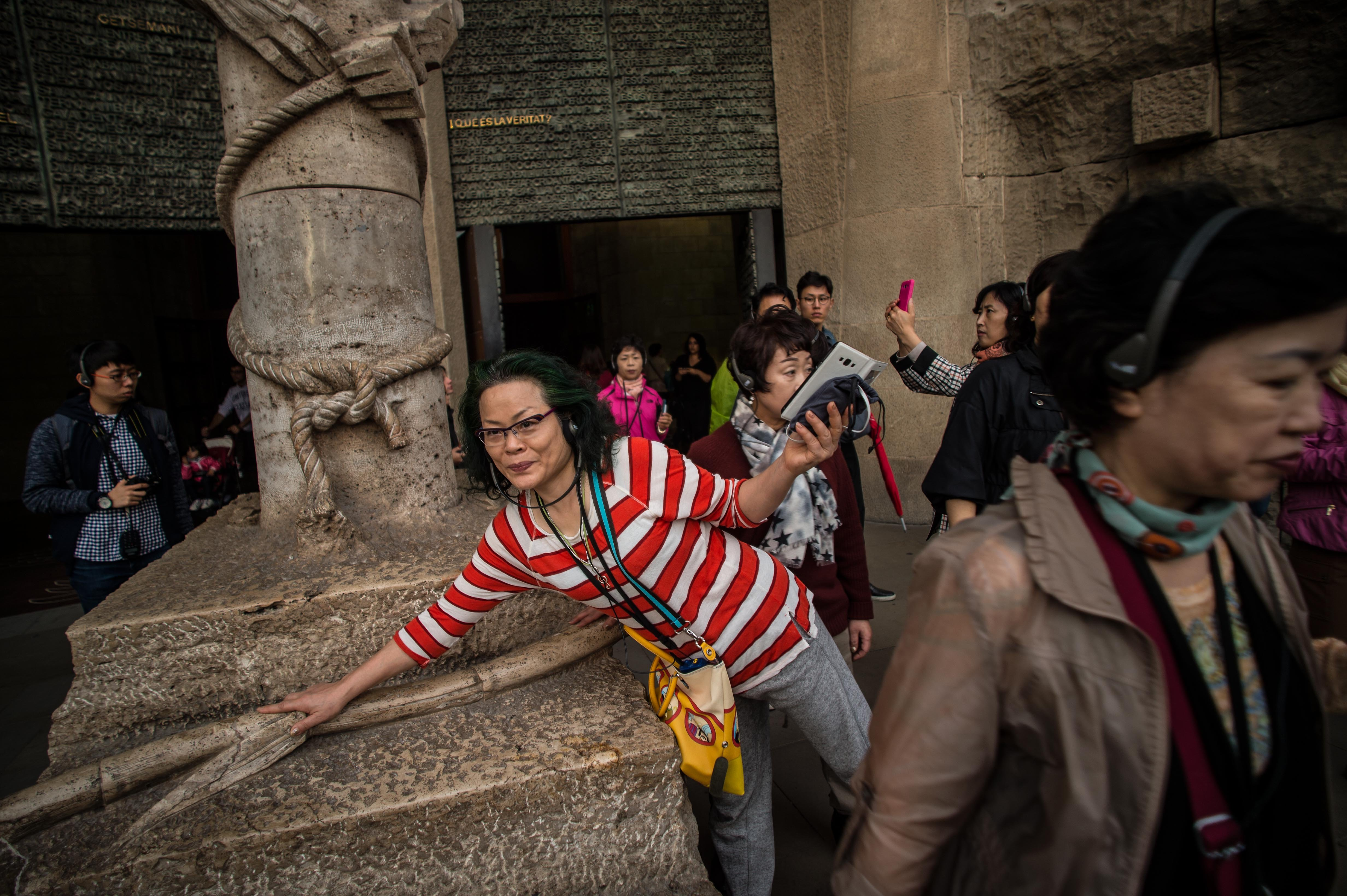 Tourists visit 'La Sagrada Familia' in Barcelona on Oct. 26, 2015.