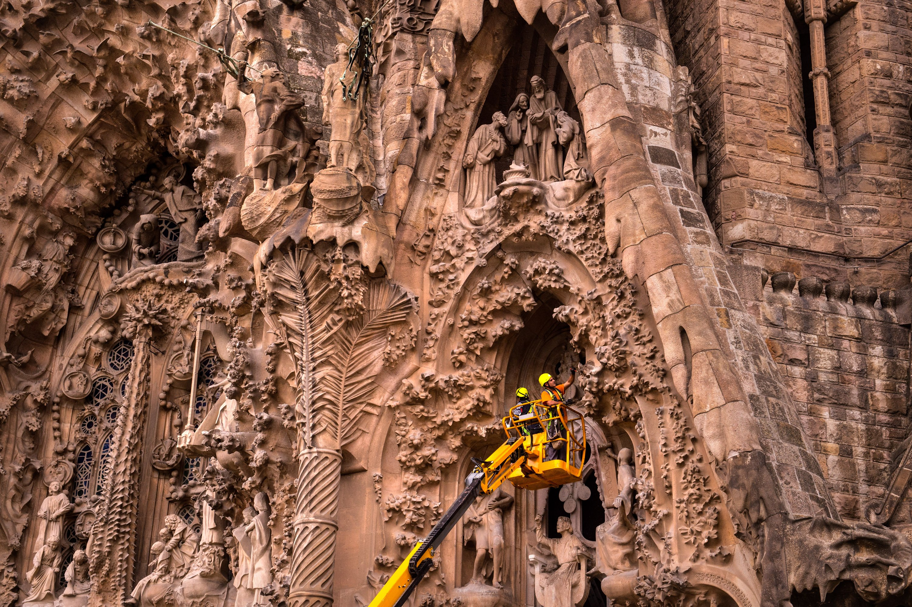 Employees work on the Birth's Facade of 'La Sagrada Familia' in Barcelona on Oct. 26, 2015.