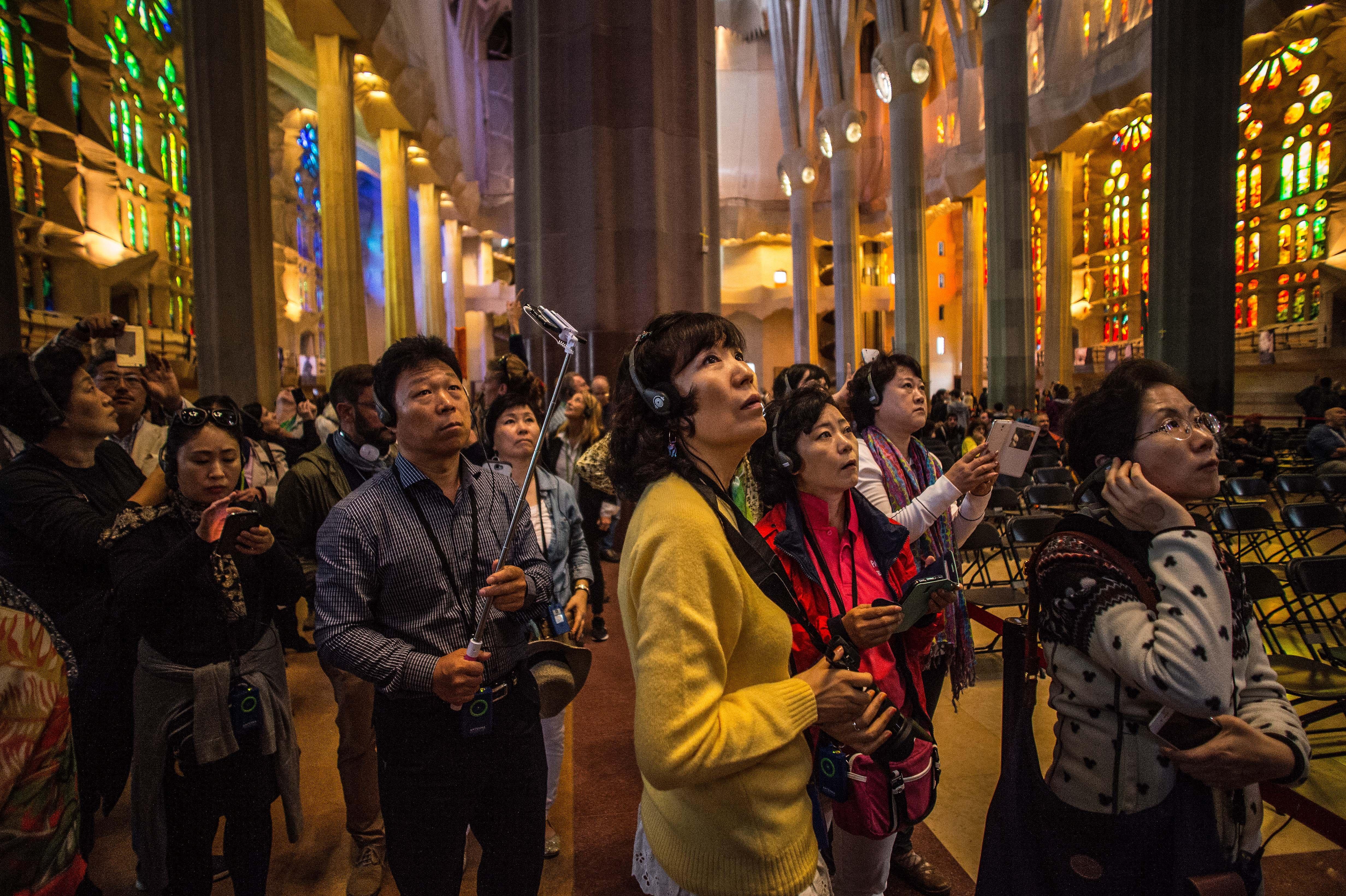 Tourists visit the Basilica of 'La Sagrada Familia' in Barcelona on Oct. 26, 2015.