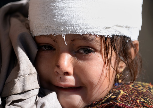 A young injured Pakistani earthquake survivor weeps at a hospital in quake-hit Shangla in Pakistan's Khyber Pakhtunkhwa province on October 28, 2015