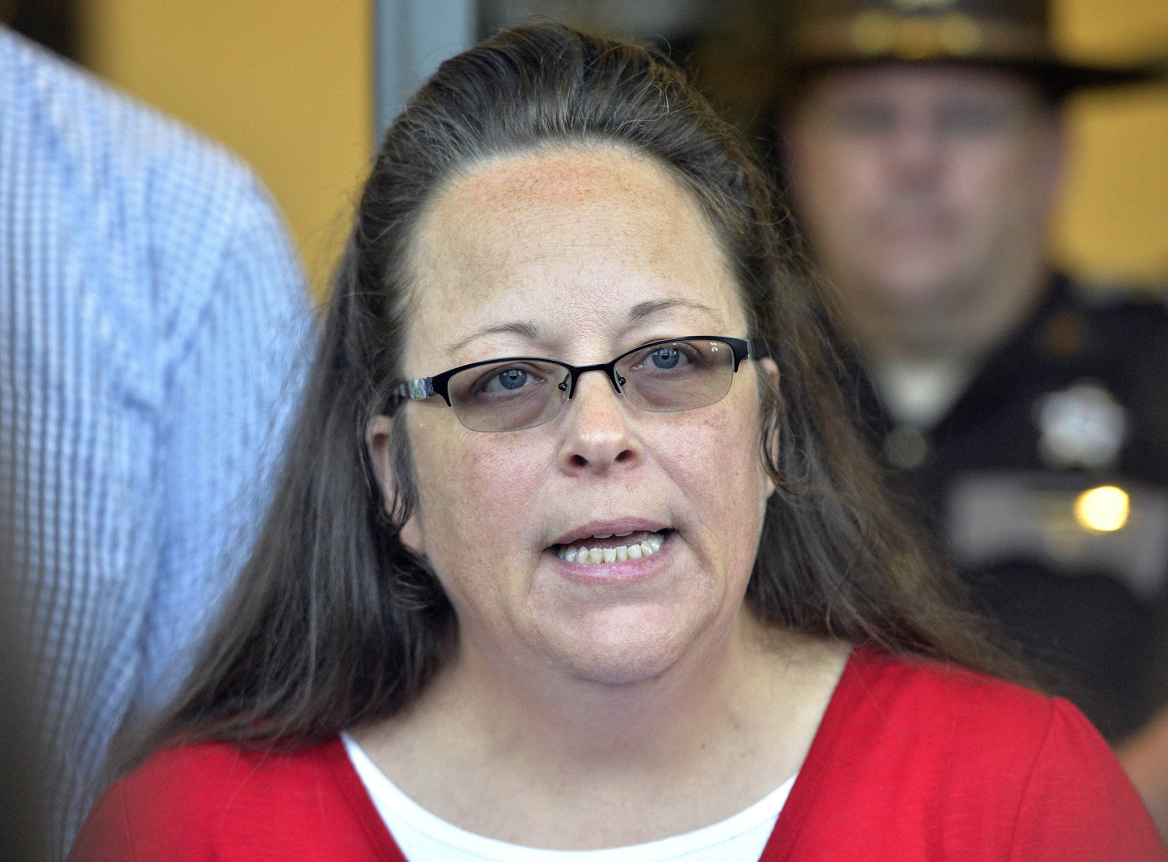 FILE - In this Sept. 14, 2015 file photo, Rowan County Clerk Kim Davis makes a statement to the media at the front door of the Rowan County Judicial Center in Morehead, Ky. On Friday, Oct. 2, 2015.