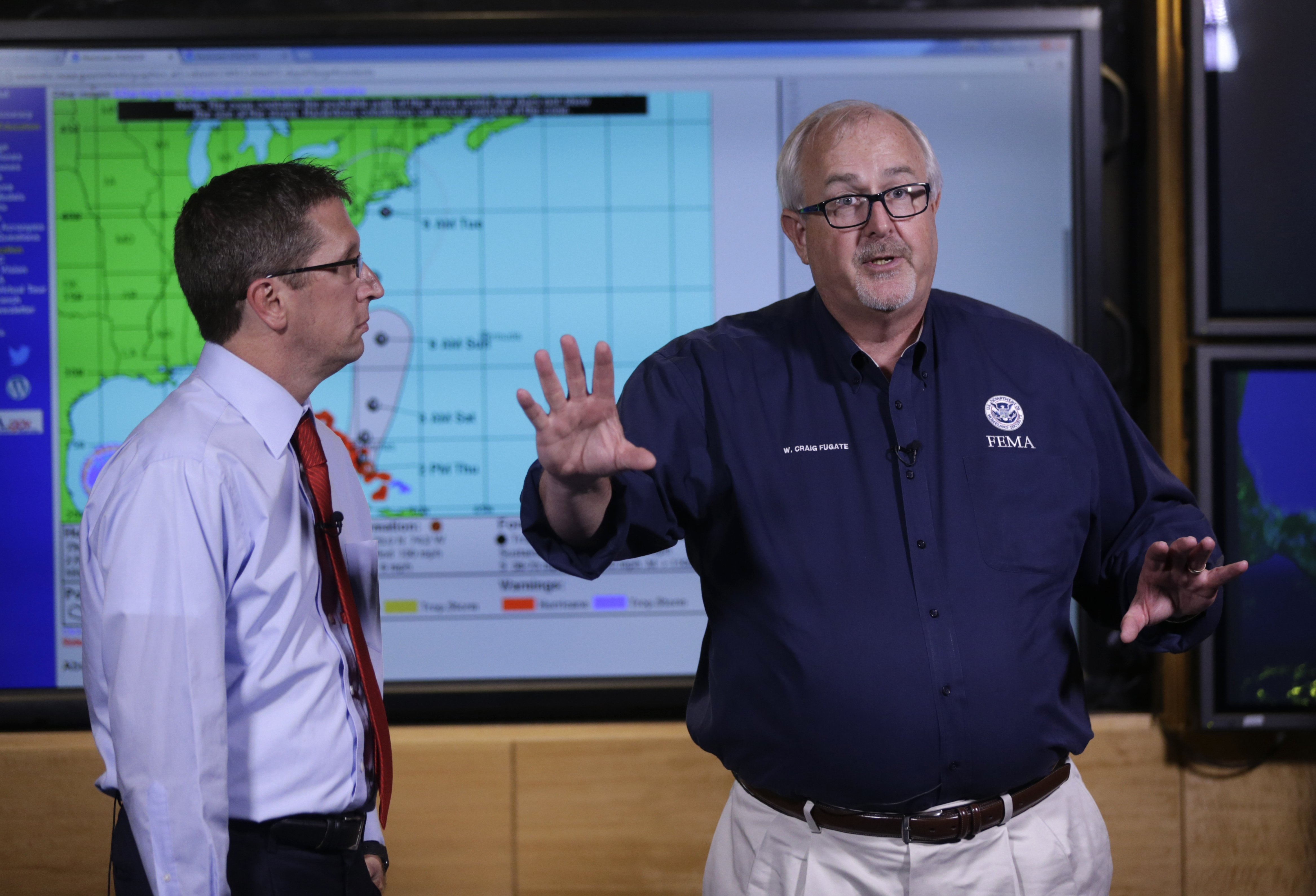 Craig Fugate, Administrator of the Federal Emergency Management Agency (FEMA), right, talks about the status of Hurricane Joaquin as it moves through the eastern Bahamas as Rick Knabb, Director of the National Hurricane Center, left, looks on at the National Hurricane Center in Miami, on Oct. 1, 2015.