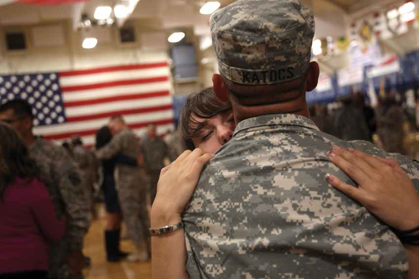 Family members and U.S. soldiers are reunited, during a welcome home ceremony for troops returning from Iraq, Fort Carson, Colo. Nov. 10, 2011.