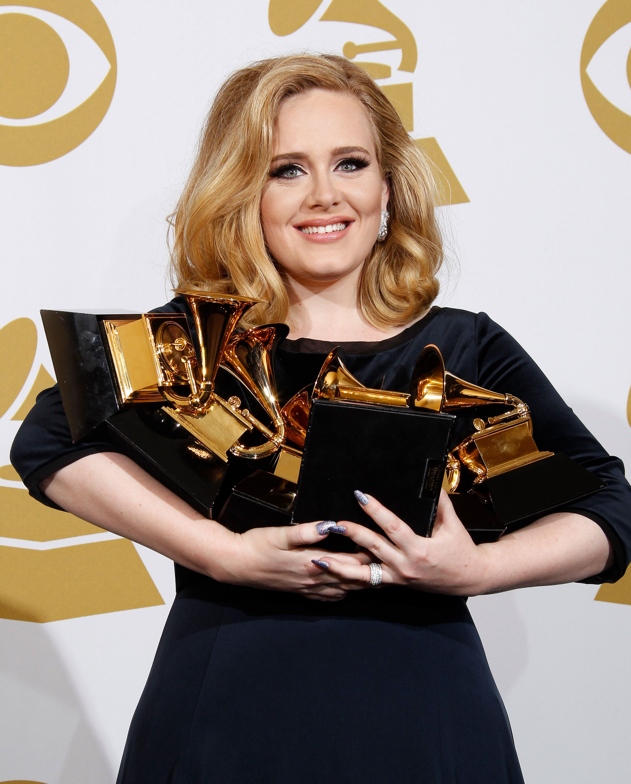 Adele poses in the press room at the 54th Annual GRAMMY Awards in Los Angeles on Feb. 12, 2012.