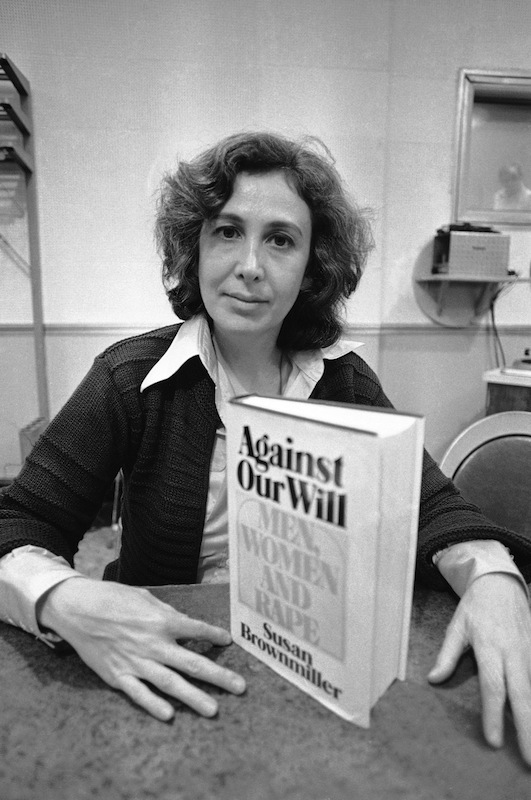 "Susan Brownmiller, poses with her book ""Against Our Will - Men, Women and Rape"" in New York City on Oct. 18, 1975"