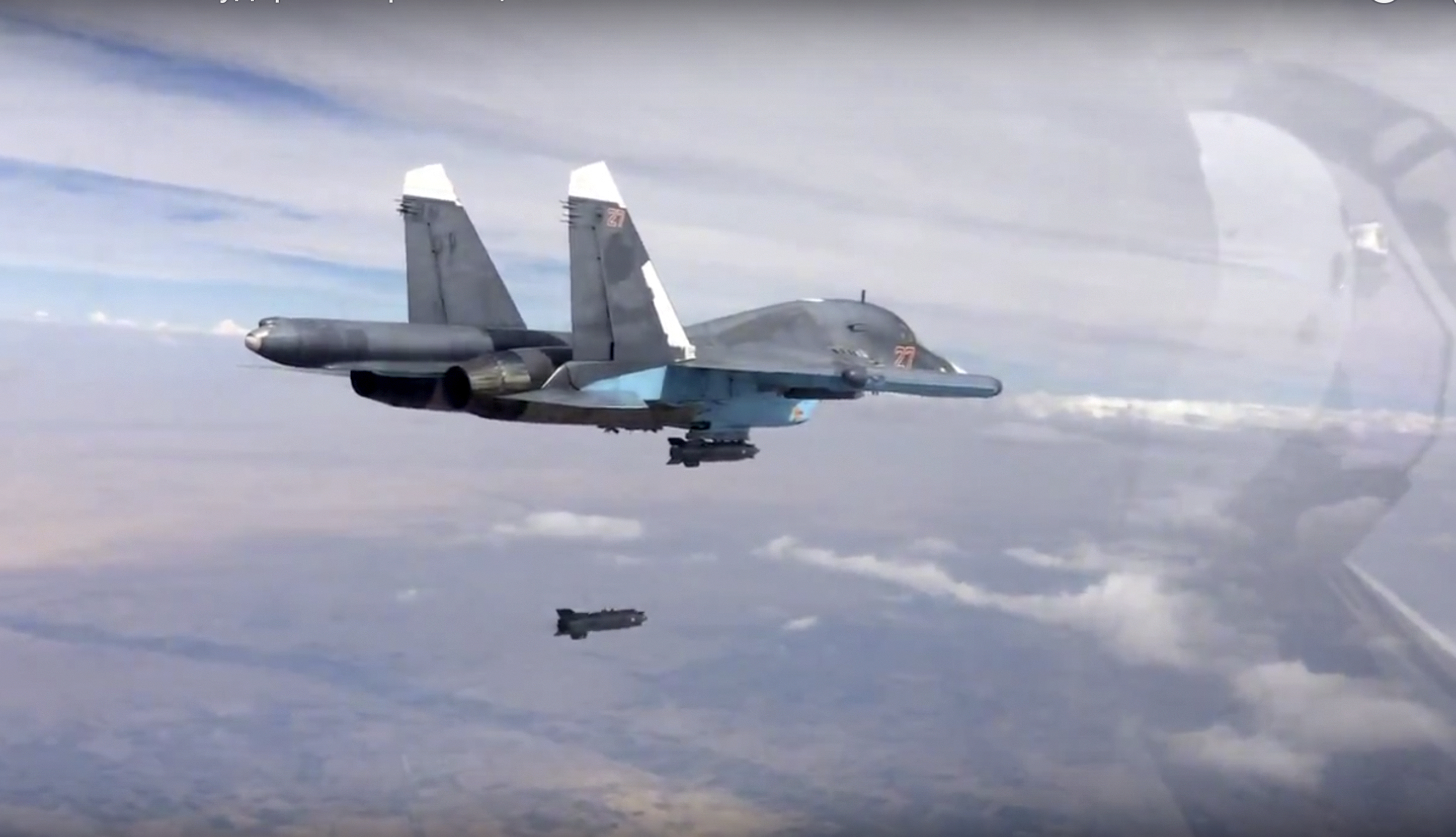In this photo made from the footage taken from Russian Defense Ministry official web site on Friday, Oct. 9, 2015, a bomb is released from Russian Su-34 strike fighter in Syria