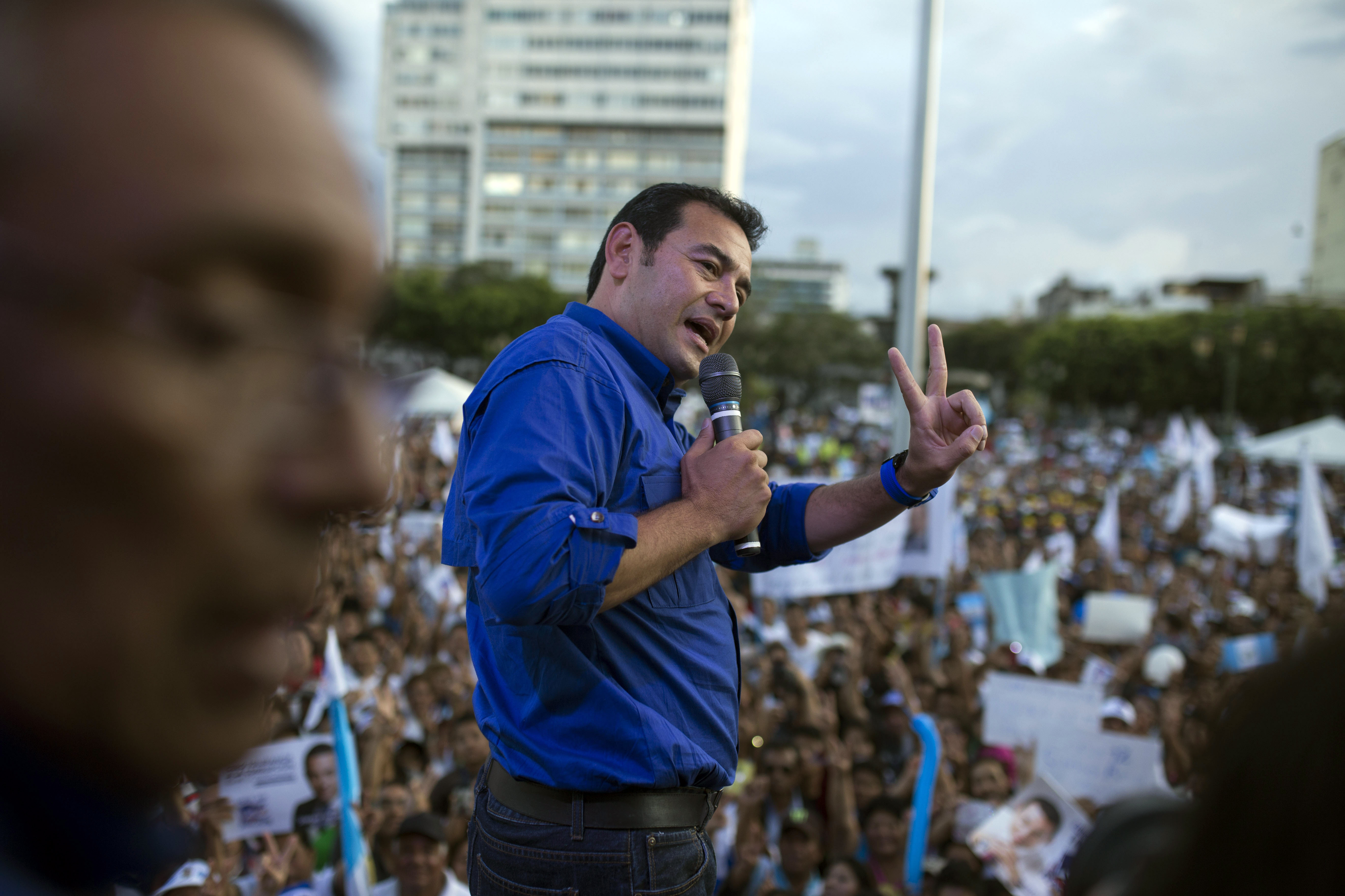 Jimmy Morales, the National Front of Convergence party presidential candidate, gives a victory sign as he speaks to supporters during a campaign rally in Guatemala City on Oct. 22, 2015
