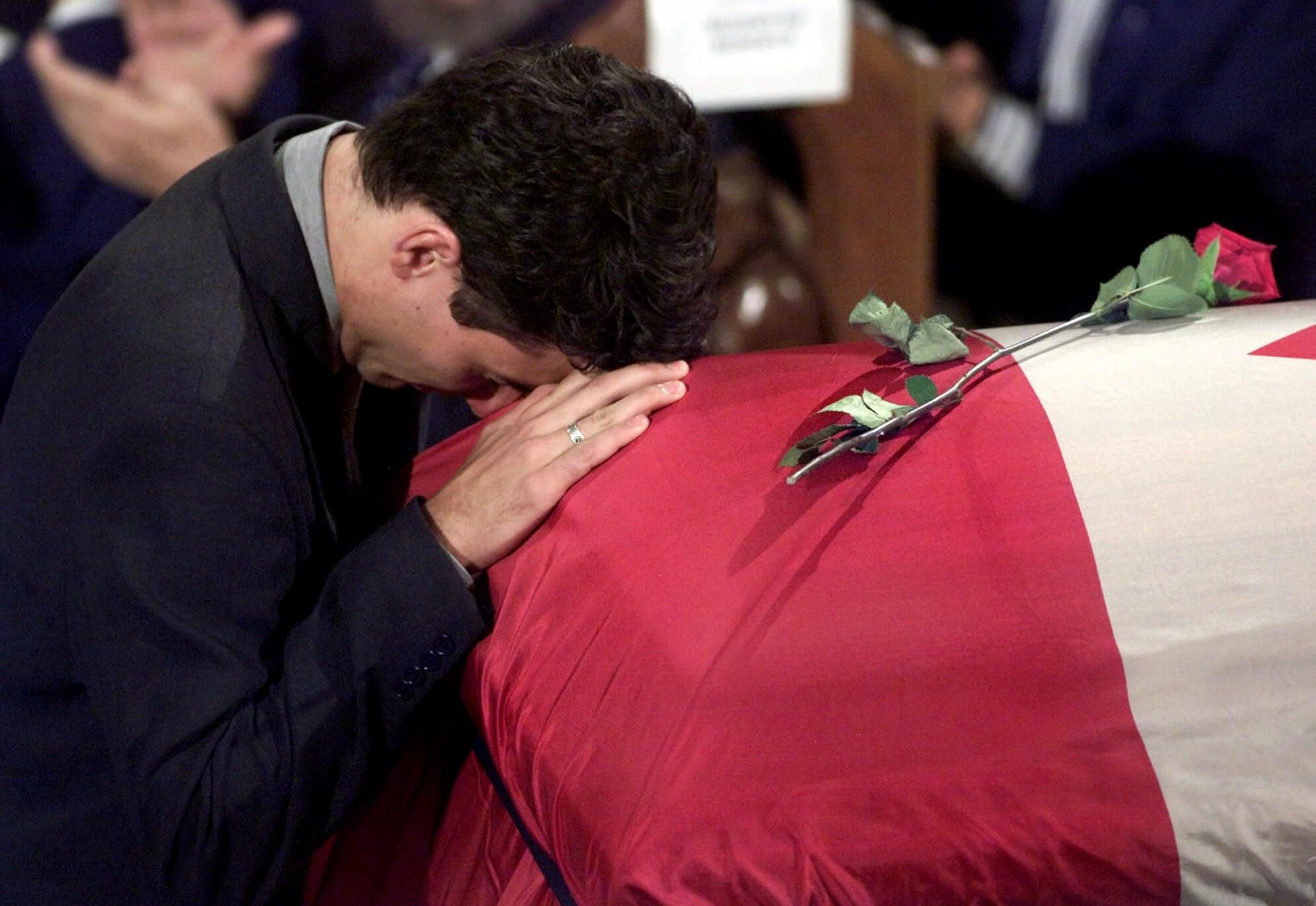 Justin Trudeau breaks down on his father's casket after reading the eulogy, in Montreal, in 2000.