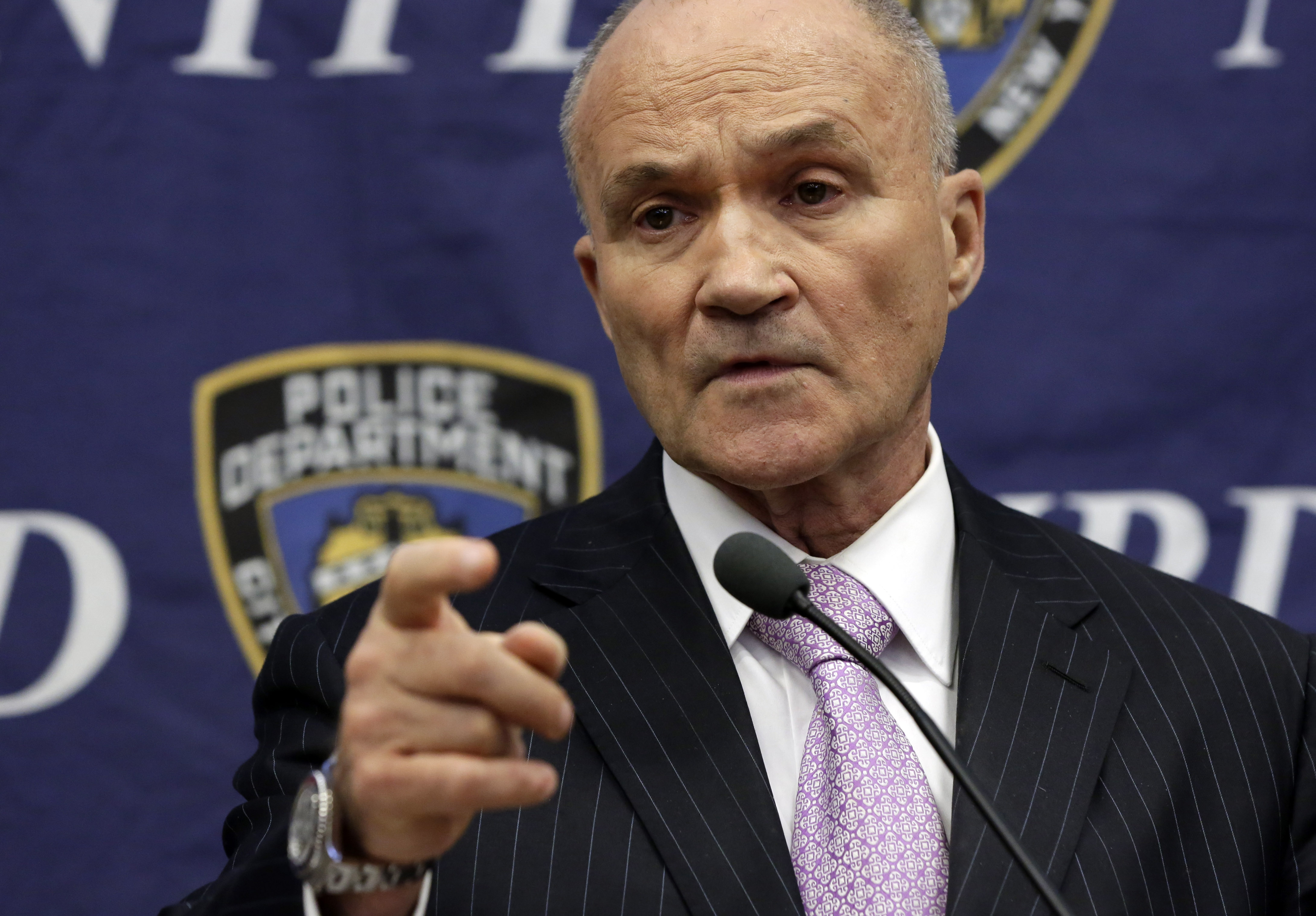 Former New York City Police Commissioner Raymond Kelly responds to a question about his department's stop-and-frisk policy, during a news conference Nov. 1, 2013. In a new book, Kelly criticizes New York City Mayor Bill de Blasio for limiting the policing tactic.
