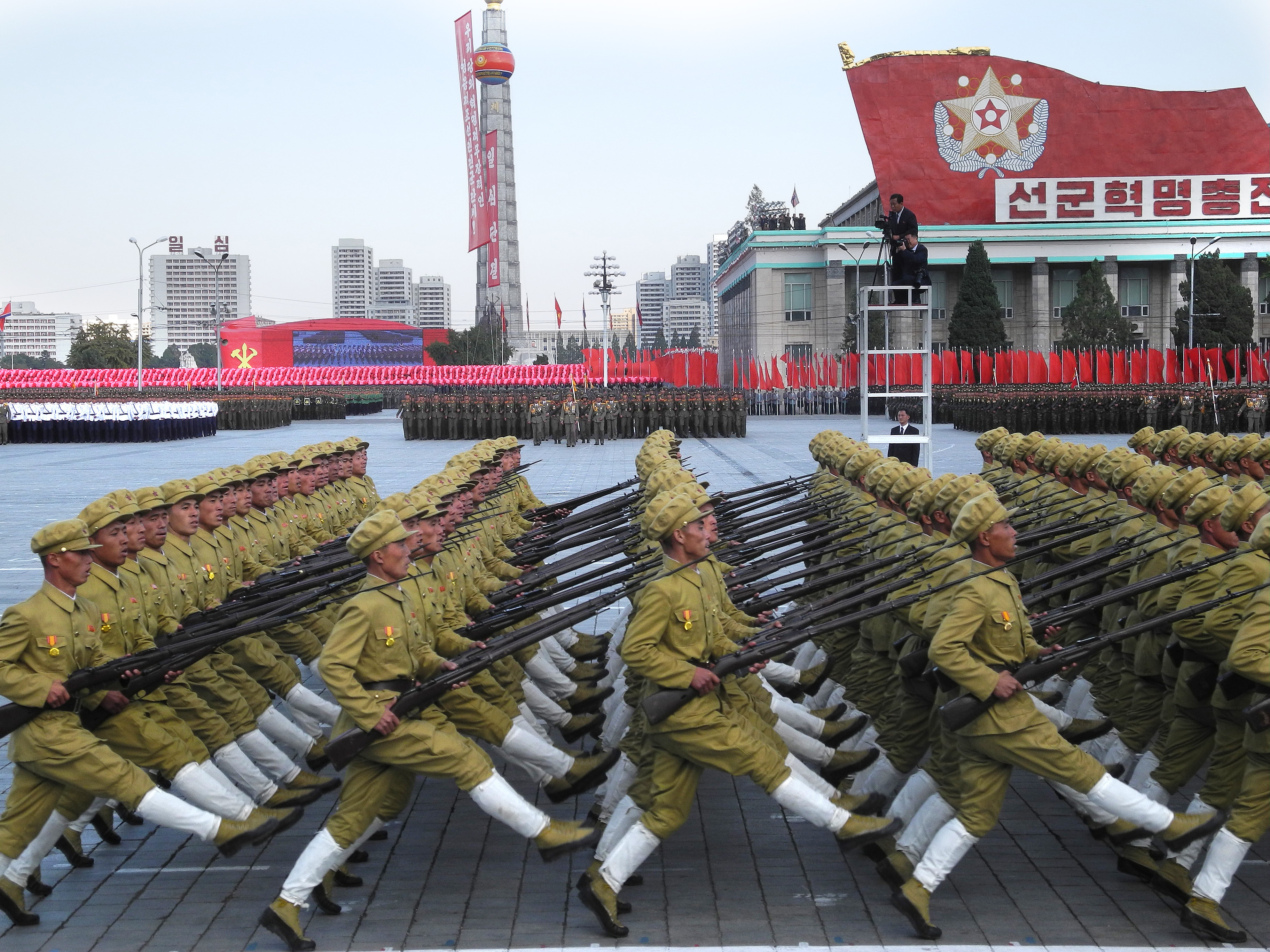 Soldiers march with bayonets during the military parade for the 70th anniversary of the founding of the ruling workers' party on Kim Il-Sung Square in Pyongyang, North Korea, on 10 Oct. 2015.