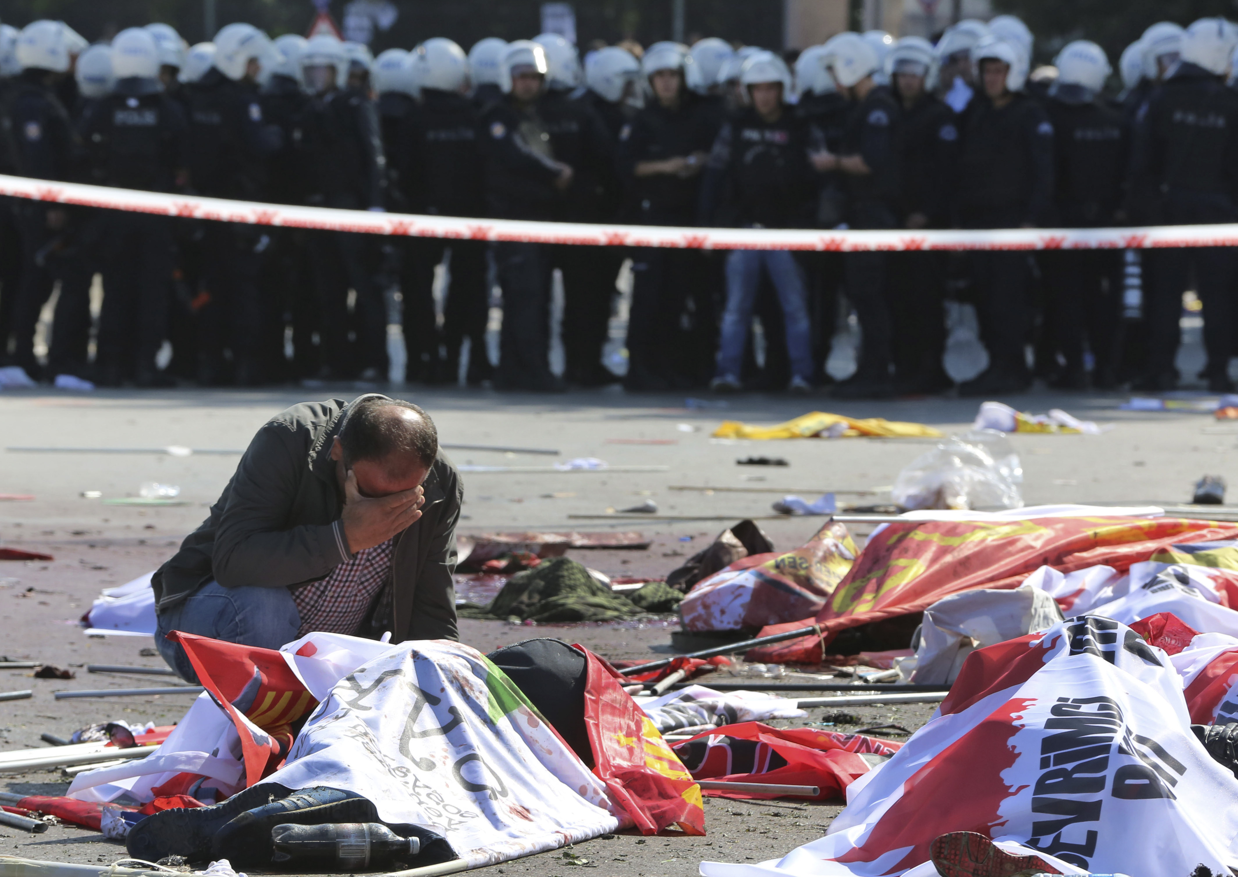 A man cries over the body of a victim, at the site of an explosion in Ankara, Turkey, on Oct. 10, 2015.