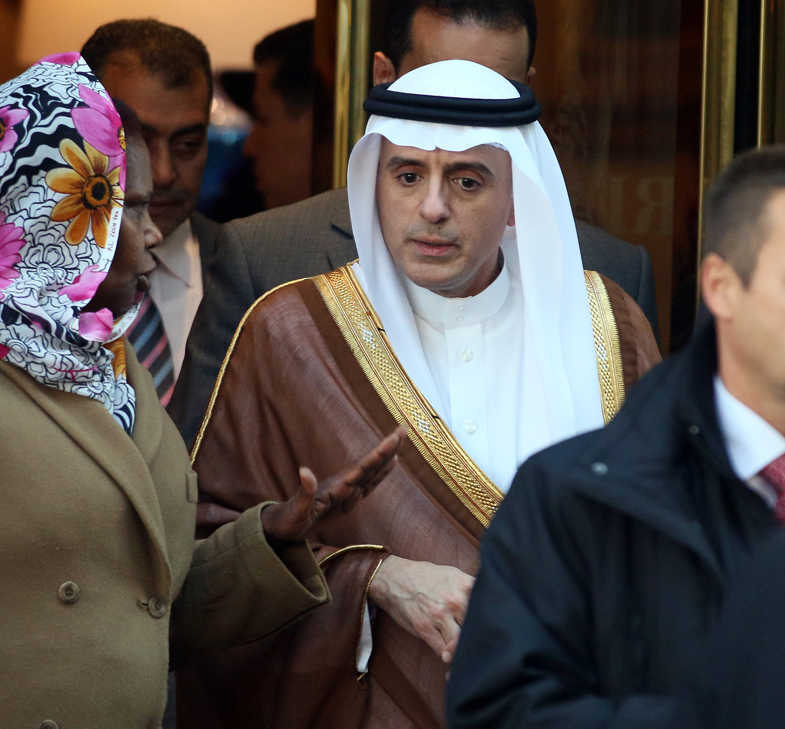 Saudi Arabia's Foreign Minister Adel al-Jubeir is leaving a hotel after a meeting in Vienna, Austria, Friday, Oct. 23, 2015.