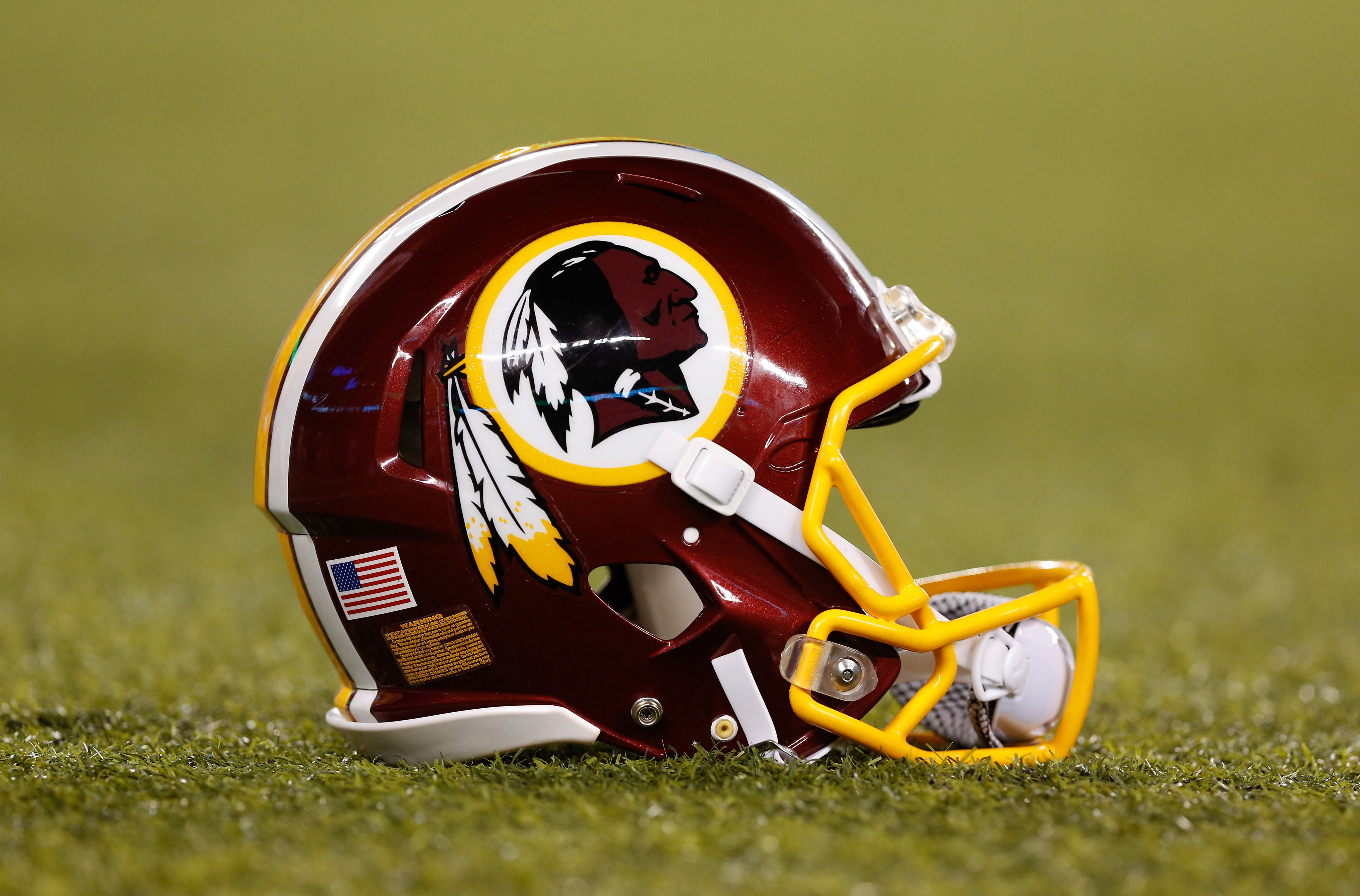 A detail view of a Washington Redskins helmet. California Governor Jerry Brown signed a bill into law Sunday banning public schools from using the term  Redskins  as a team name or mascot.