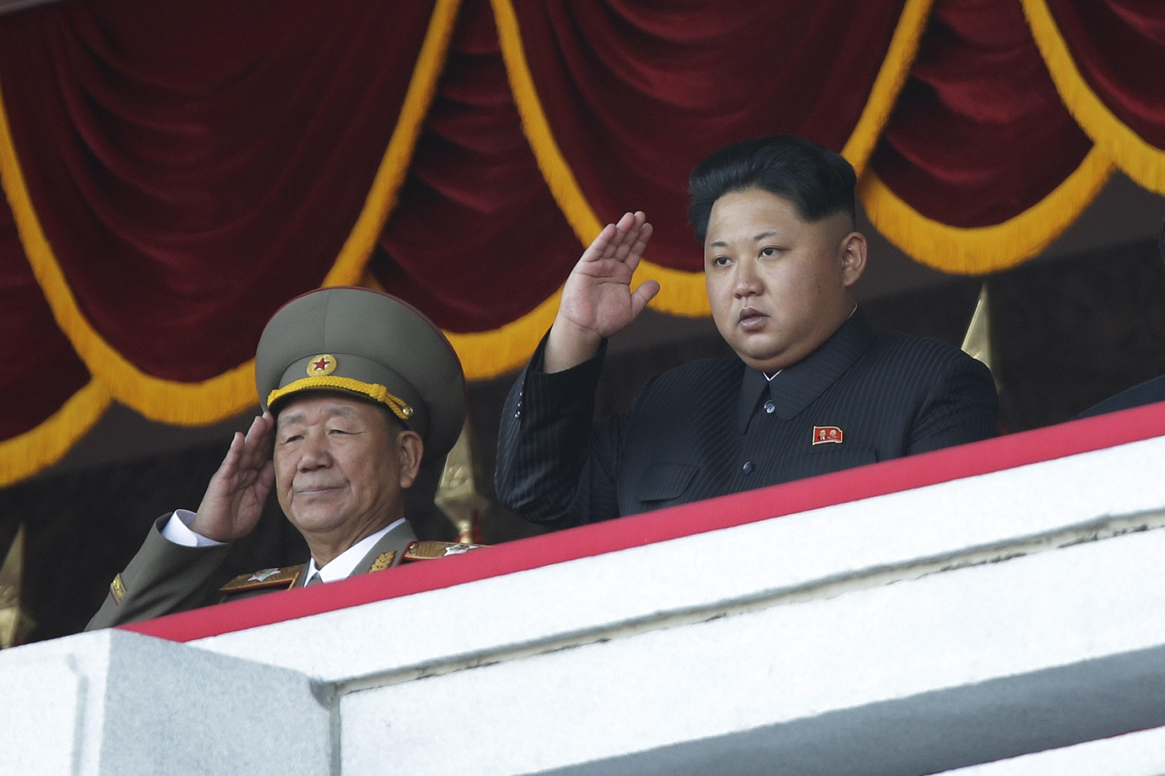 North Korean leader Kim Jong Un, right, salutes at a parade in Pyongyang, North Korea, on Oct. 10, 2015.