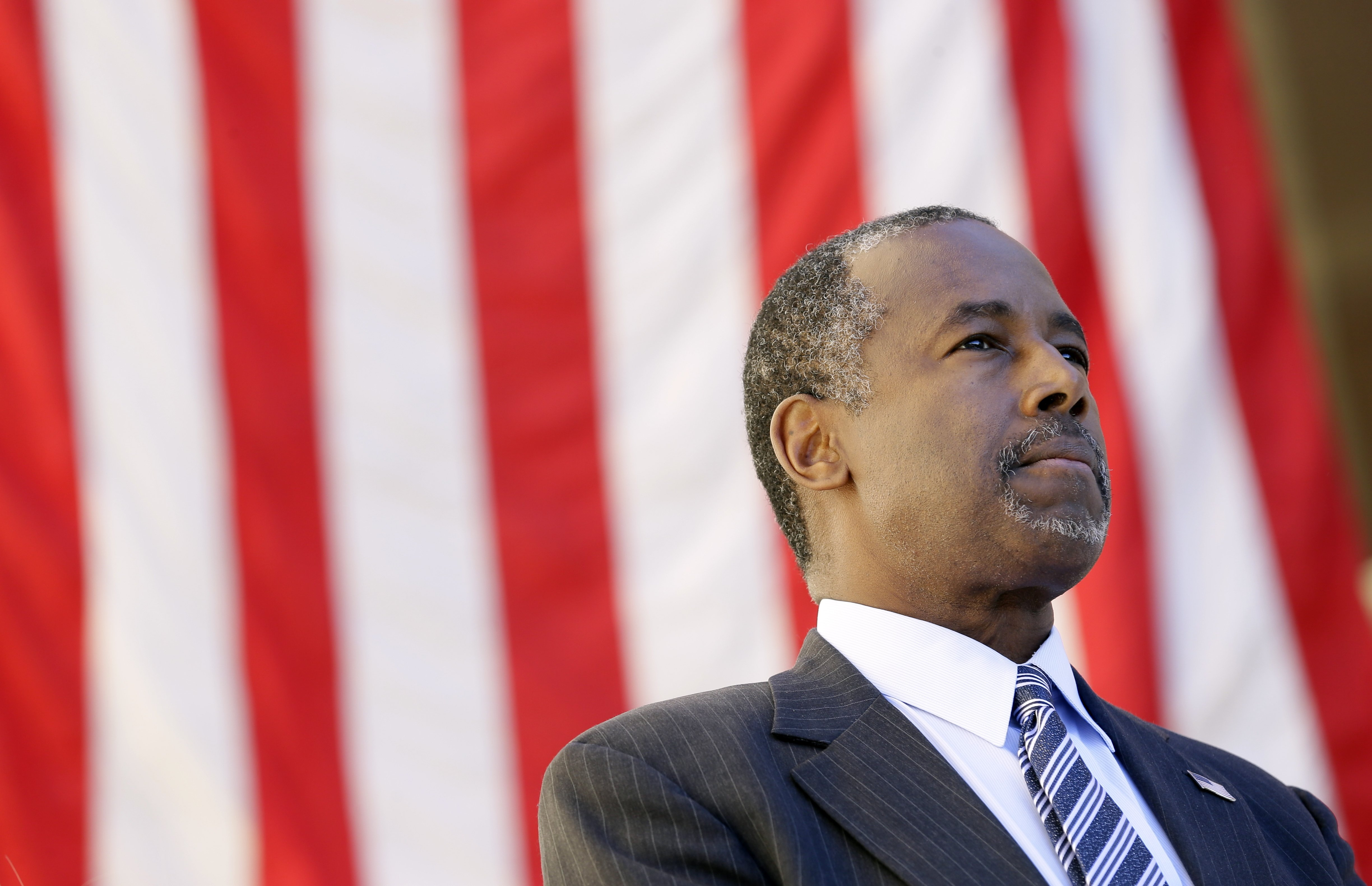 Ben Carson looks on as he is introduced to speak at a town hall meeting, on Oct. 2, 2015, in Ankeny, IA.