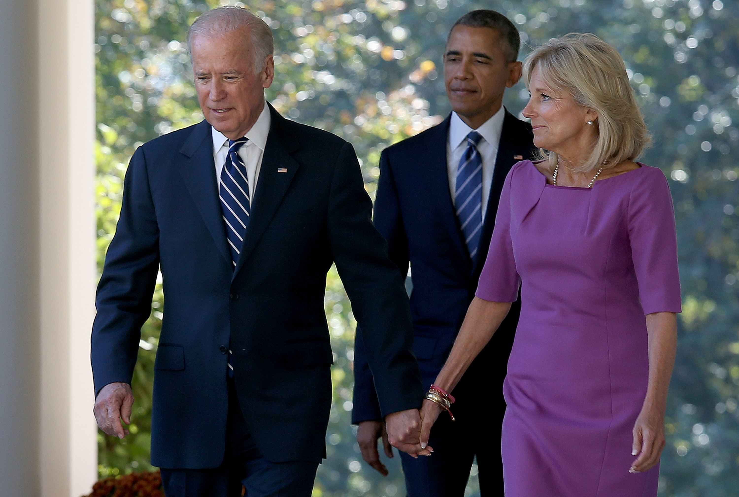 Vice President Joe Biden, followed by U.S. President Barack Obama, holds hands with his wife Jill Biden while walking to the Rose Garden to announce that he will not seek the presidency.