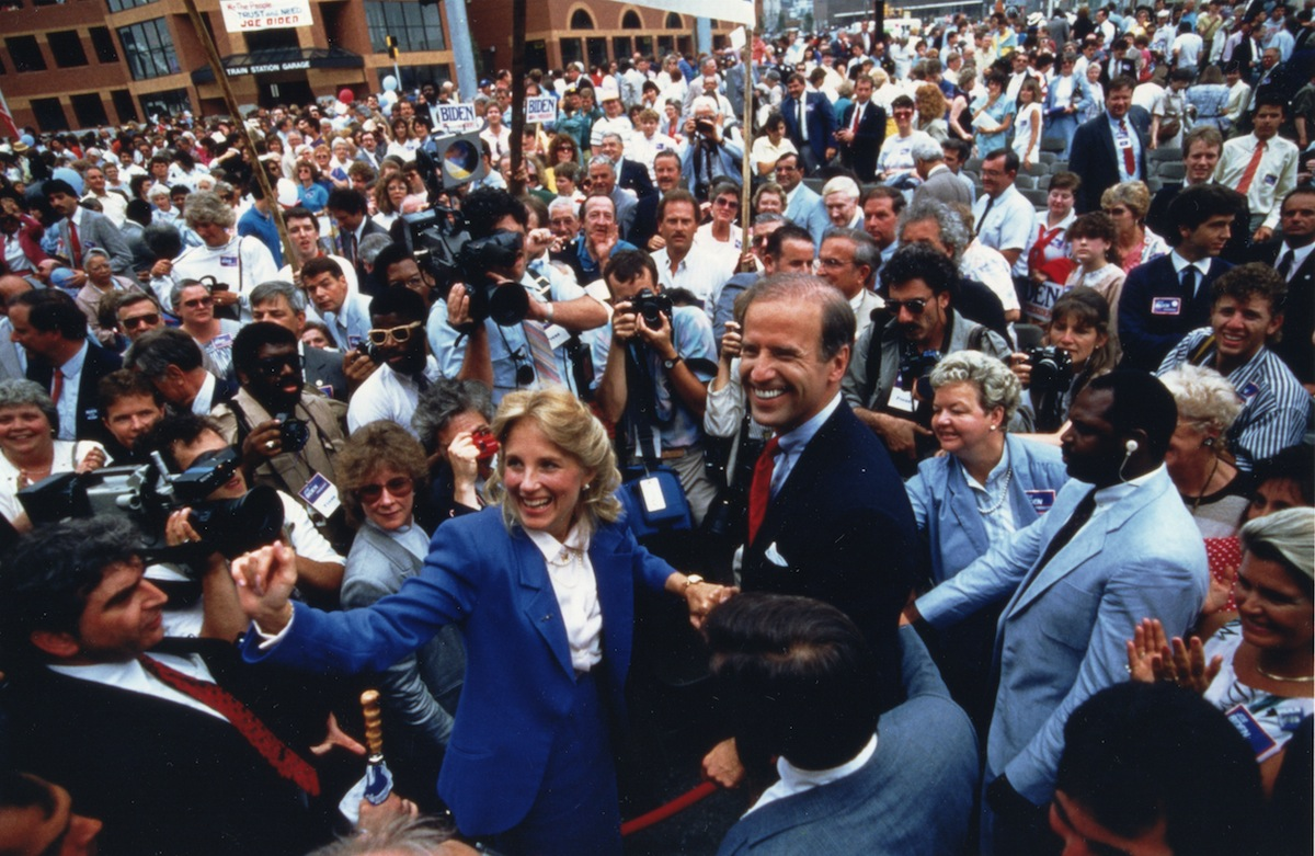 Senator Joseph Biden of Delaware and his wife, Jill, are surrounded by supporters and representatives of the news media at a rally, Wilmington, Delaware, 1988.