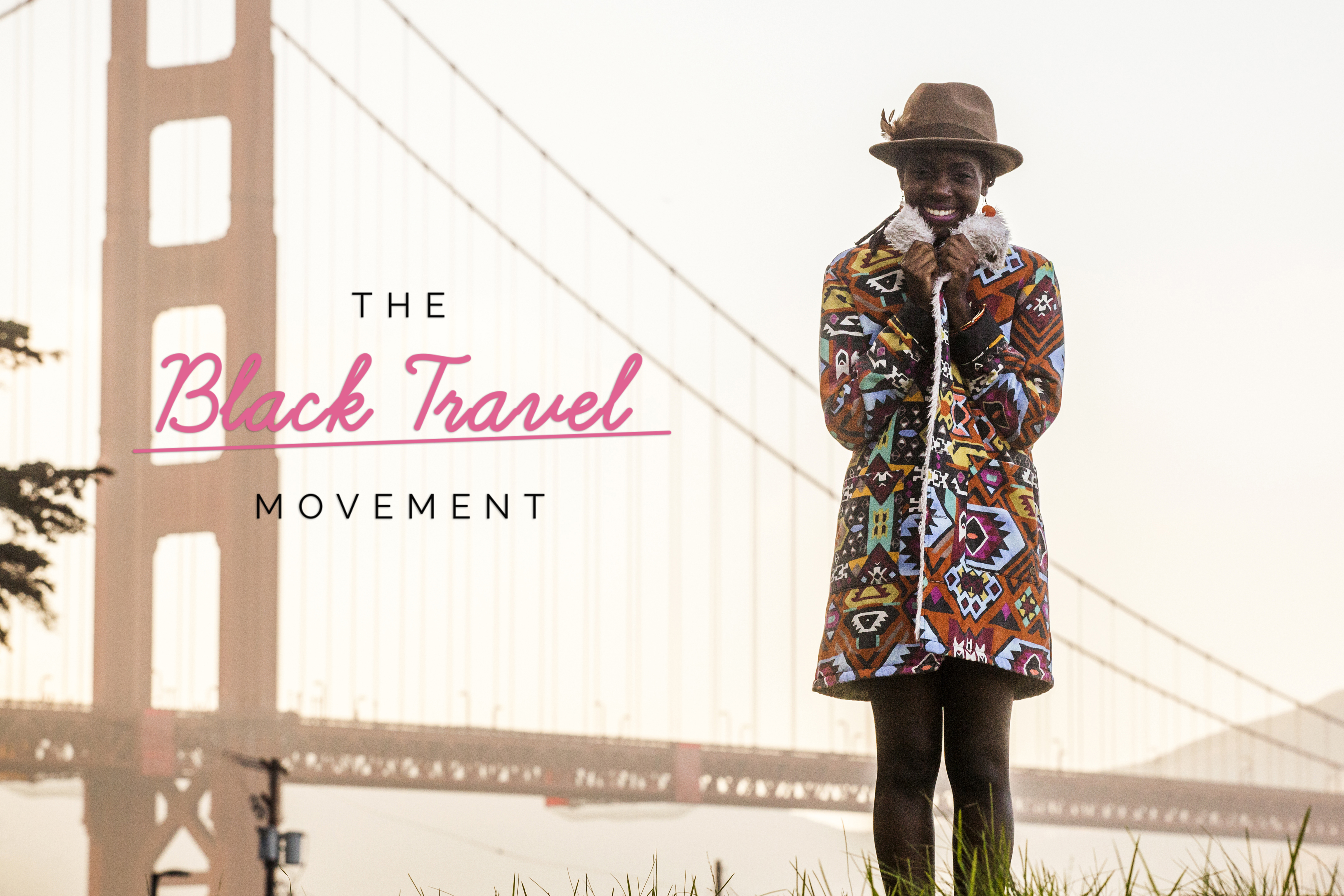 Black woman wearing colorful coat by Golden Gate Bridge, San Francisco, California, United States