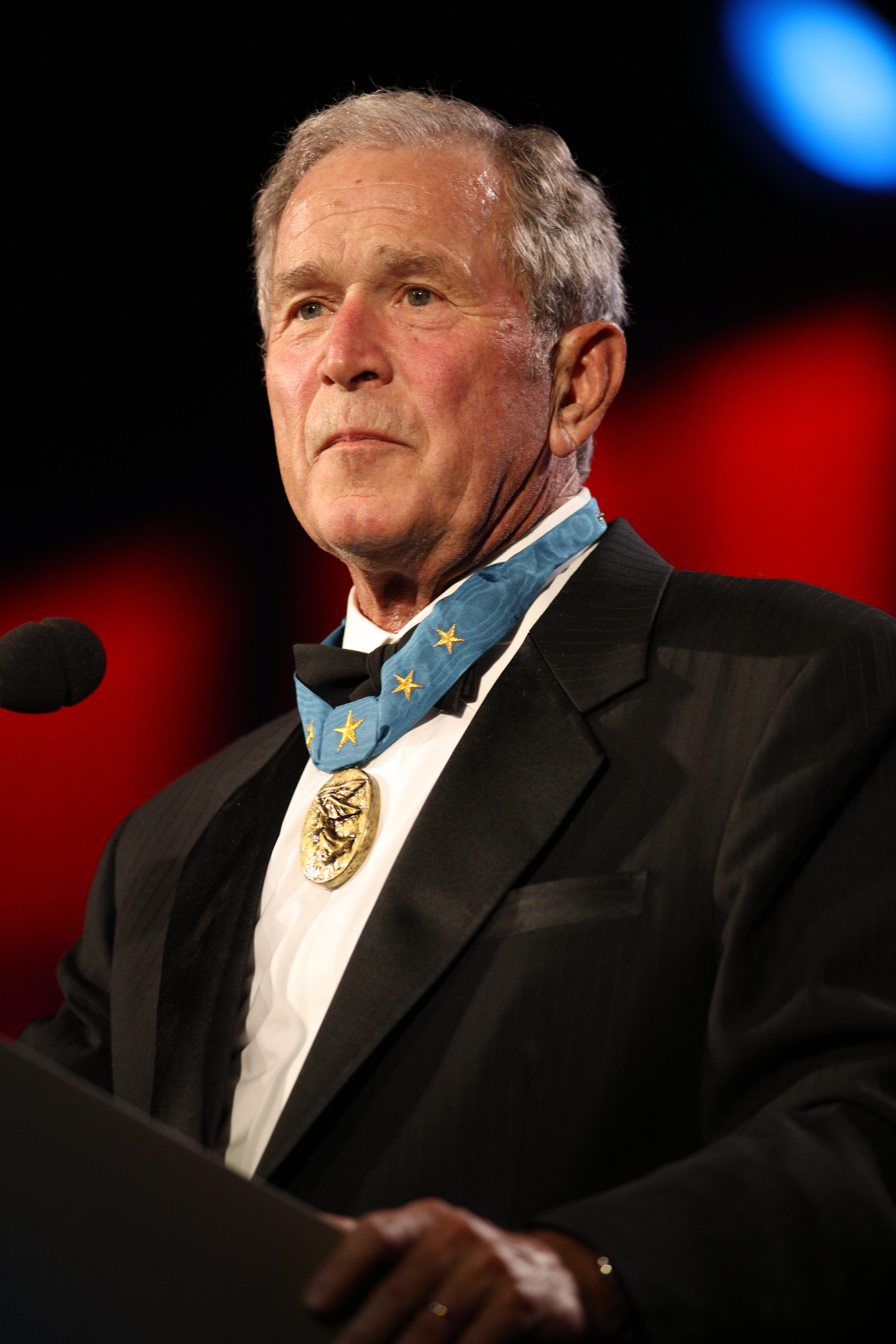 George W. Bush takes the stage at the 2015 Starkey Hearing Foundation So The World May Hear Gala in St. Paul, Minn., at the St. Paul RiverCentre on July 26, 2015.