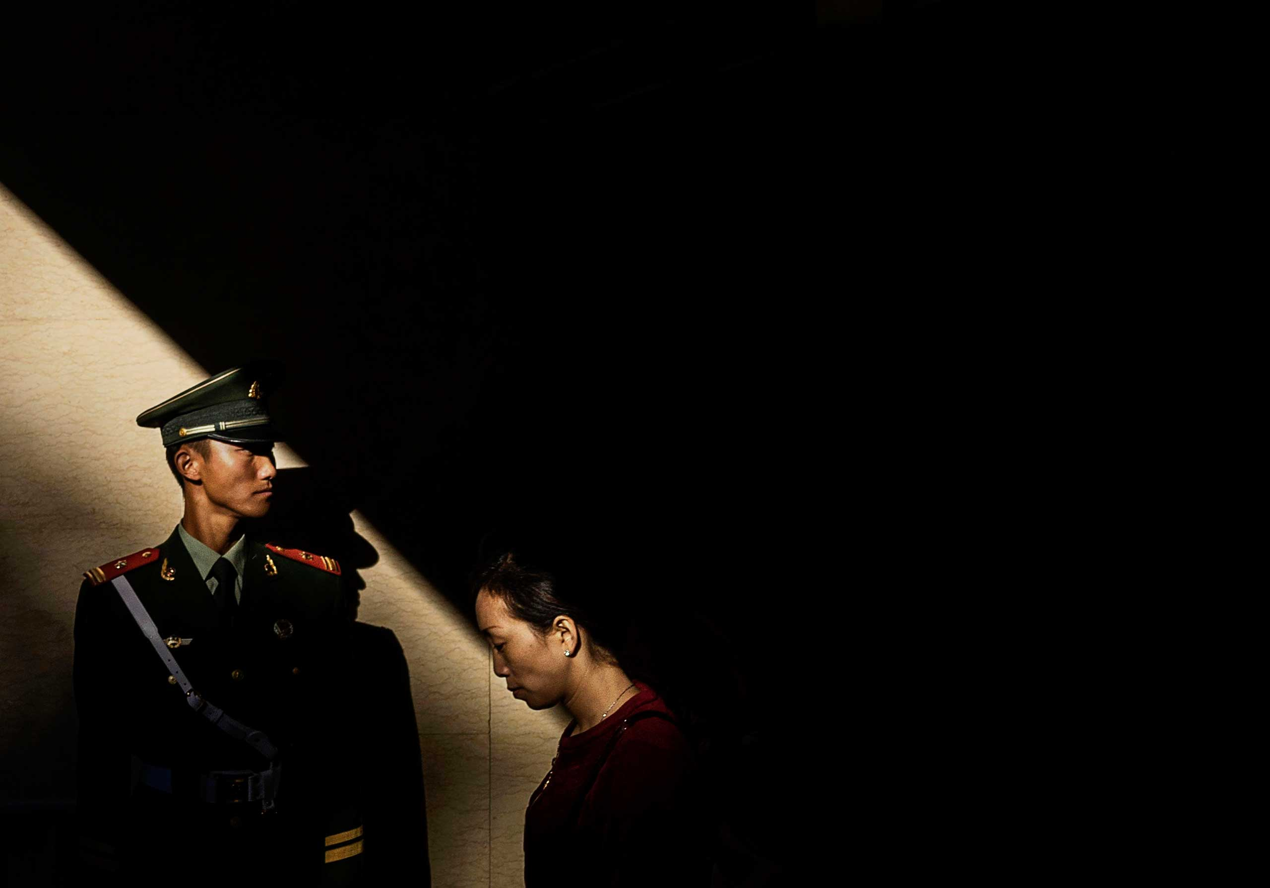 A paramilitary police officer guards in an underground tunnel after securing the official flag raising ceremony at Tiananmen Square to mark the 66th National Day in Beijing,  on Oct. 1, 2015.