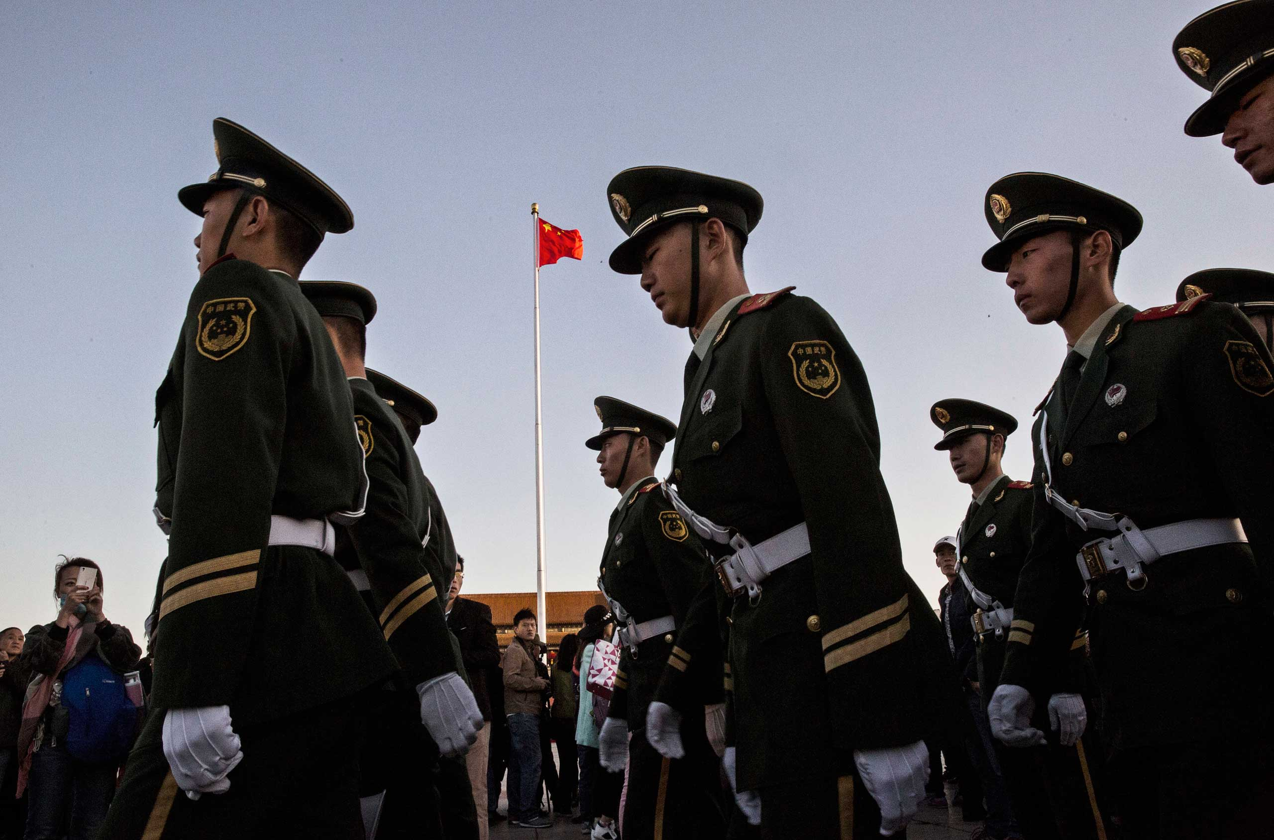 Paramilitary police officers march following the official flag raising ceremony at Tiananmen Square to mark the 66th National Day in Beijing, on Oct. 1, 2015.