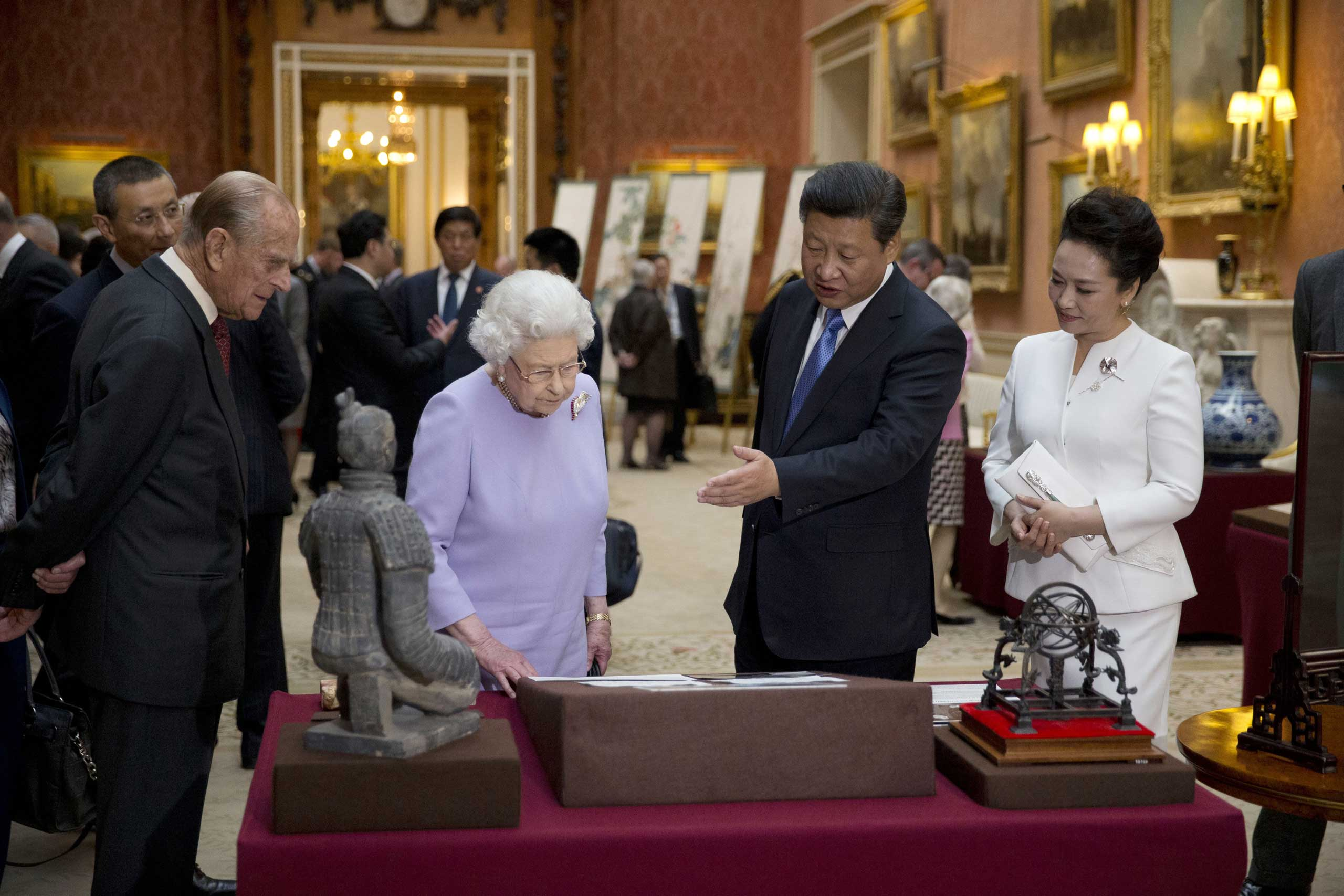 President Xi Jinping and First Lady Peng Liyuan with Queen Elizabeth II, and Prince Philip, Duke of Edinburgh view a display of Chinese items from the Royal Collection at Buckingham Palace in London, on Oct. 20, 2015