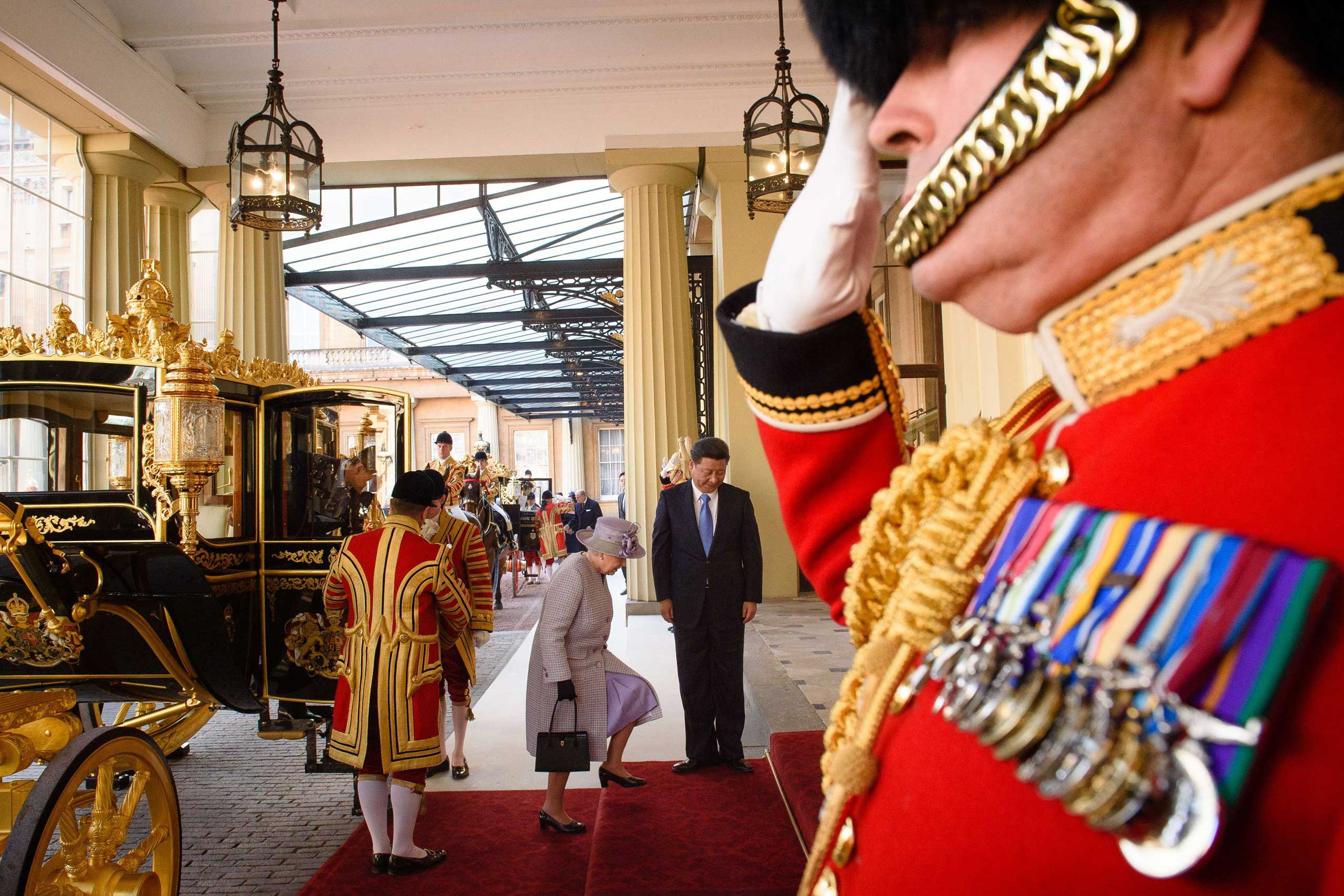 Queen Elizabeth II and President Xi arrive at Buckingham Palace in central London, on Oct. 20, 2015.