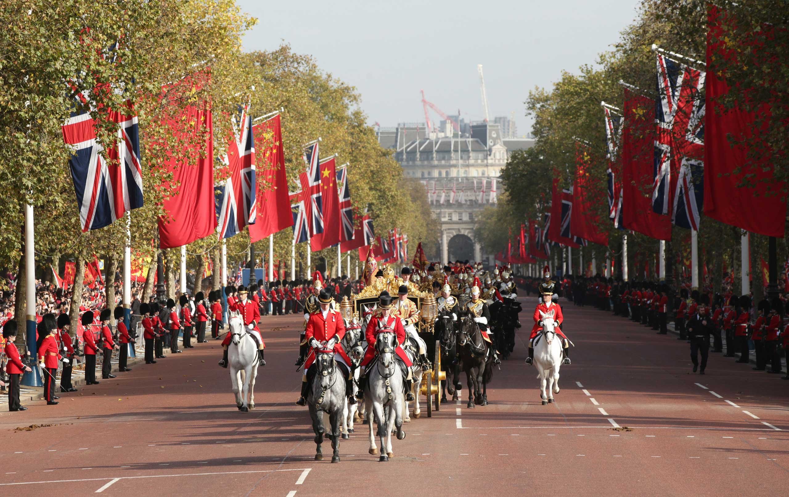 Queen Elizabeth II and President Xi, ride in the Diamond Jubilee State Coach along The Mall after the ceremonial welcome on Horse Guards Parade in London, on Oct. 20, 2015.