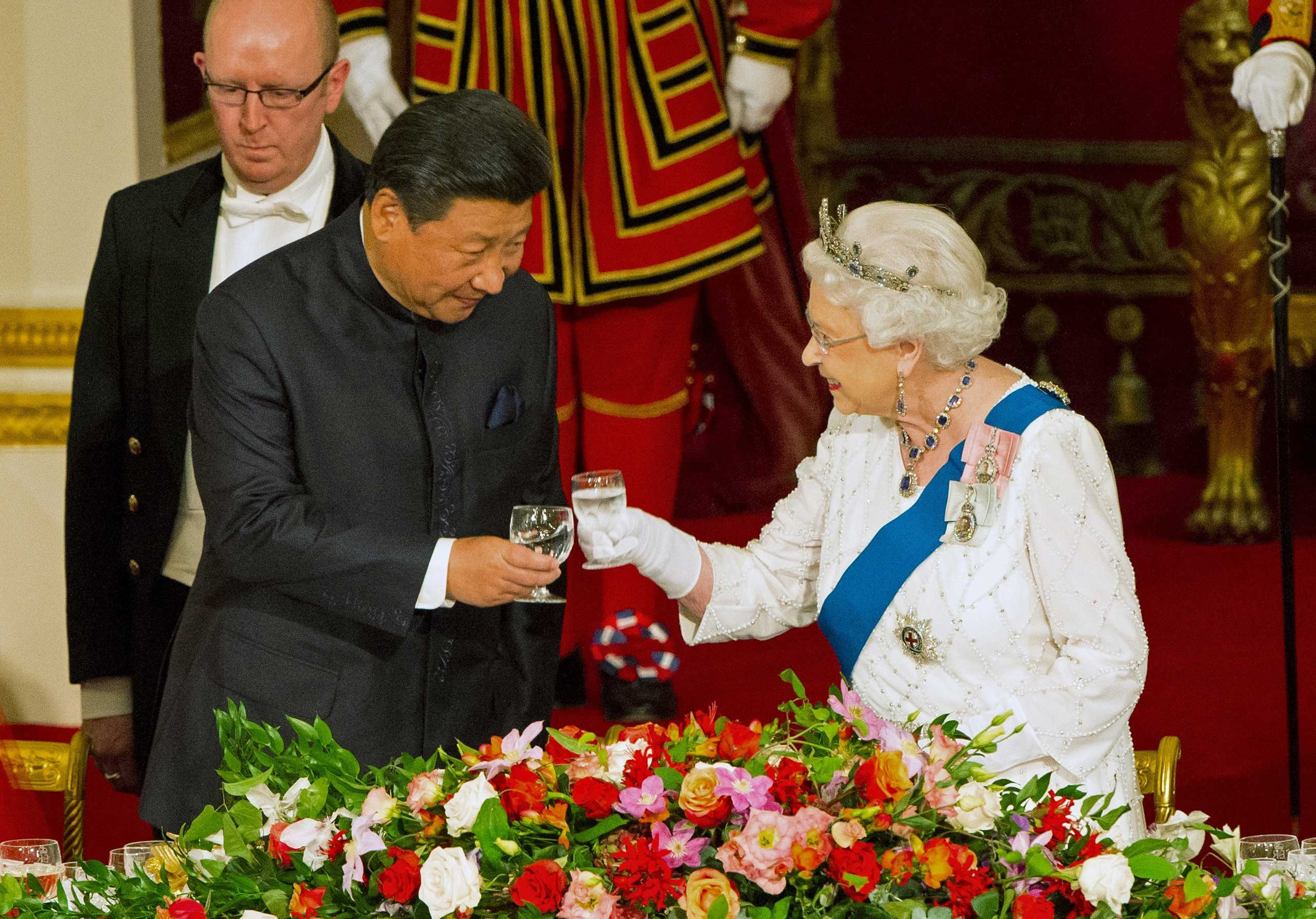 President Xi Jinping with Queen Elizabeth II at a state banquet at Buckingham Palace, in London, on Oct. 20, 2015.