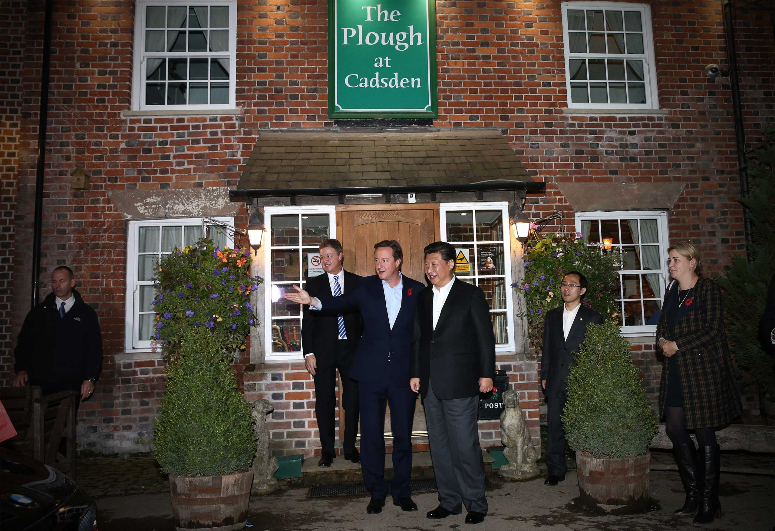 Prime Minister David Cameron leaves The Plough pub with China's president Xi Jinping in Princes Risborough, England, on Oct. 22, 2015