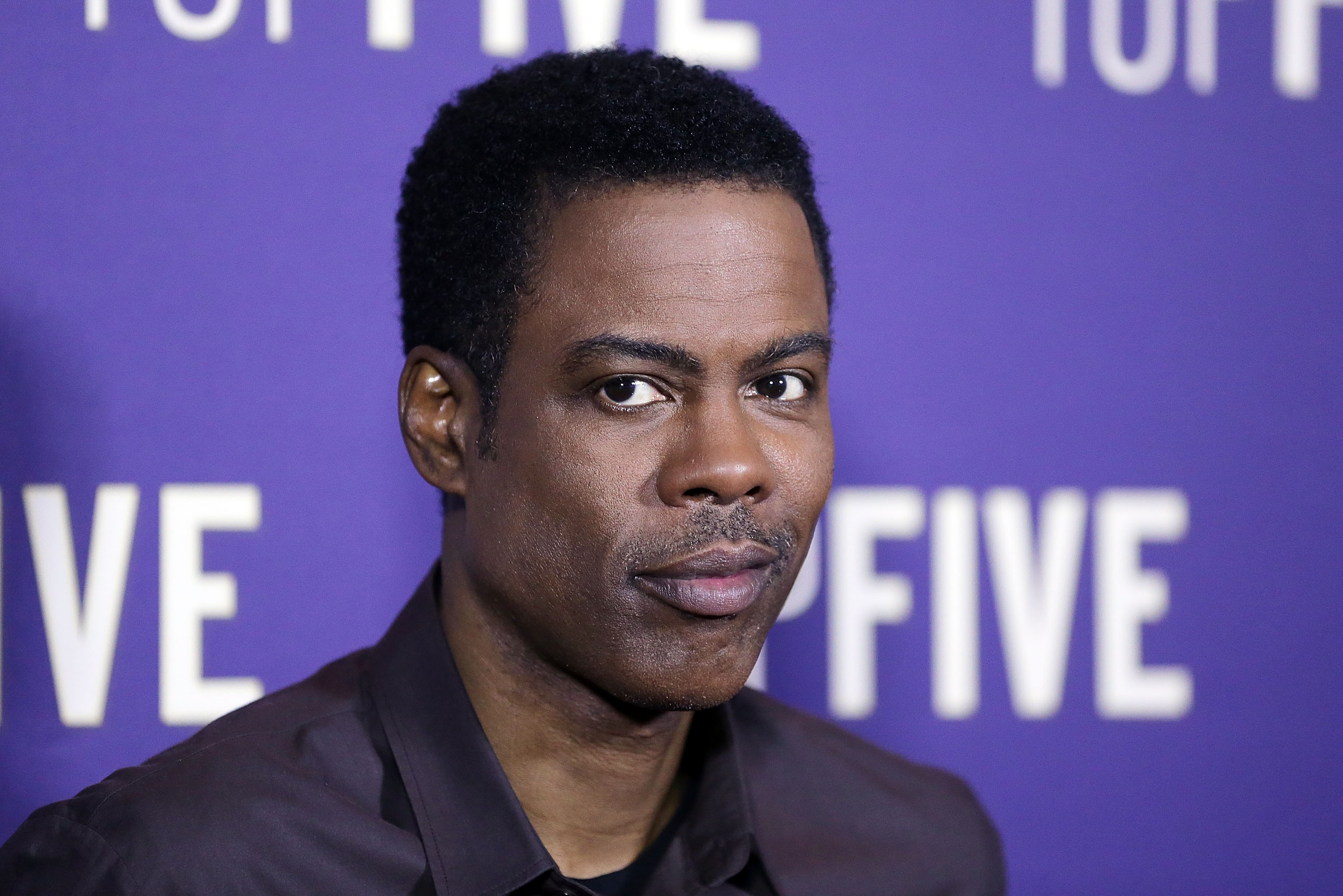 Chris Rock arrives at the  Top Five  special screening on March 4, 2015 in Sydney, Australia.