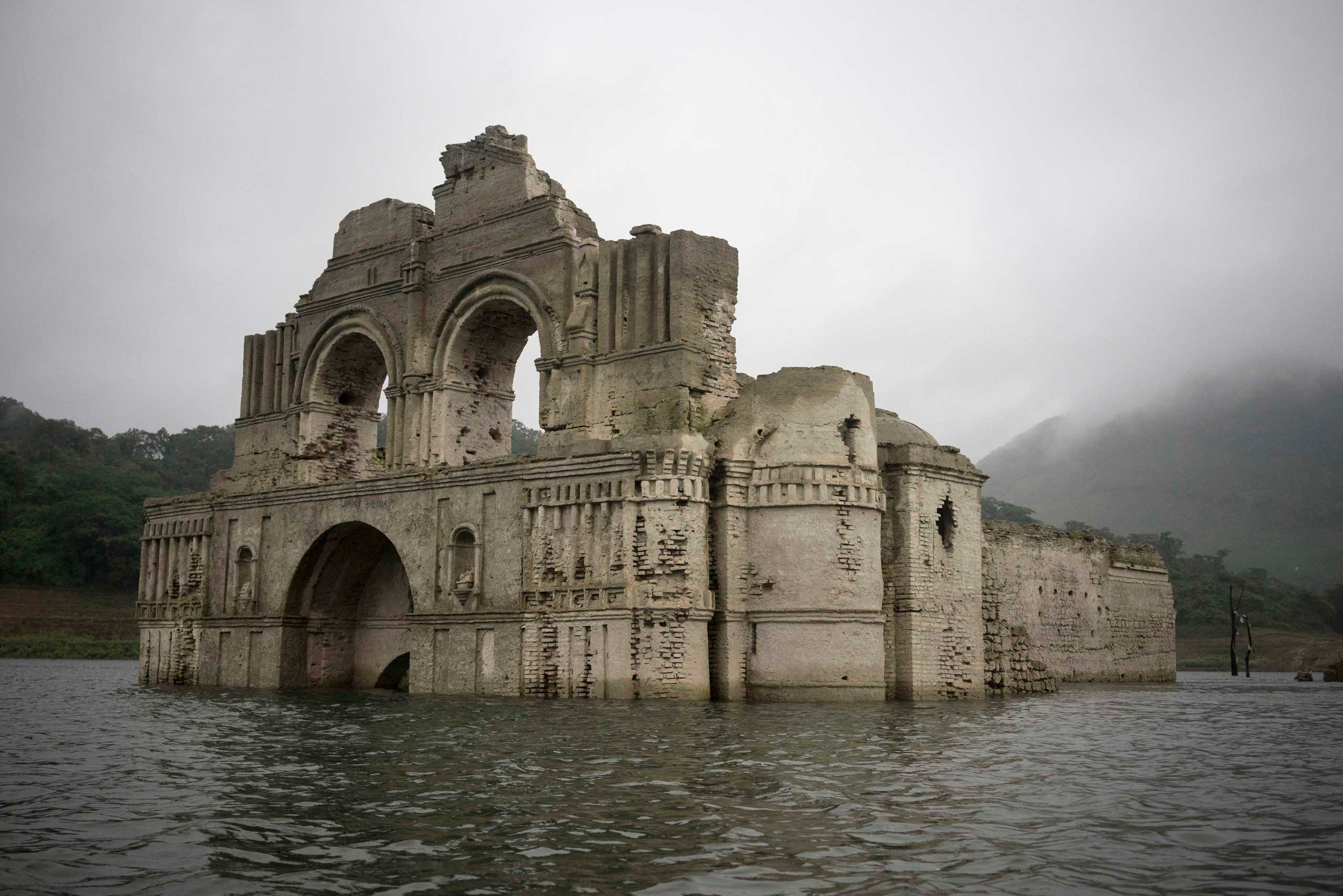 The remains of a mid-16th century church known as the Temple of Santiago, as well as the Temple of Quechula, is visible from the surface of the Grijalva River, which feeds the Nezahualcoyotl reservoir, due to the lack of rain near the town of Nueva Quechula, in Chiapas state, Mexico, Oct. 16, 2015.