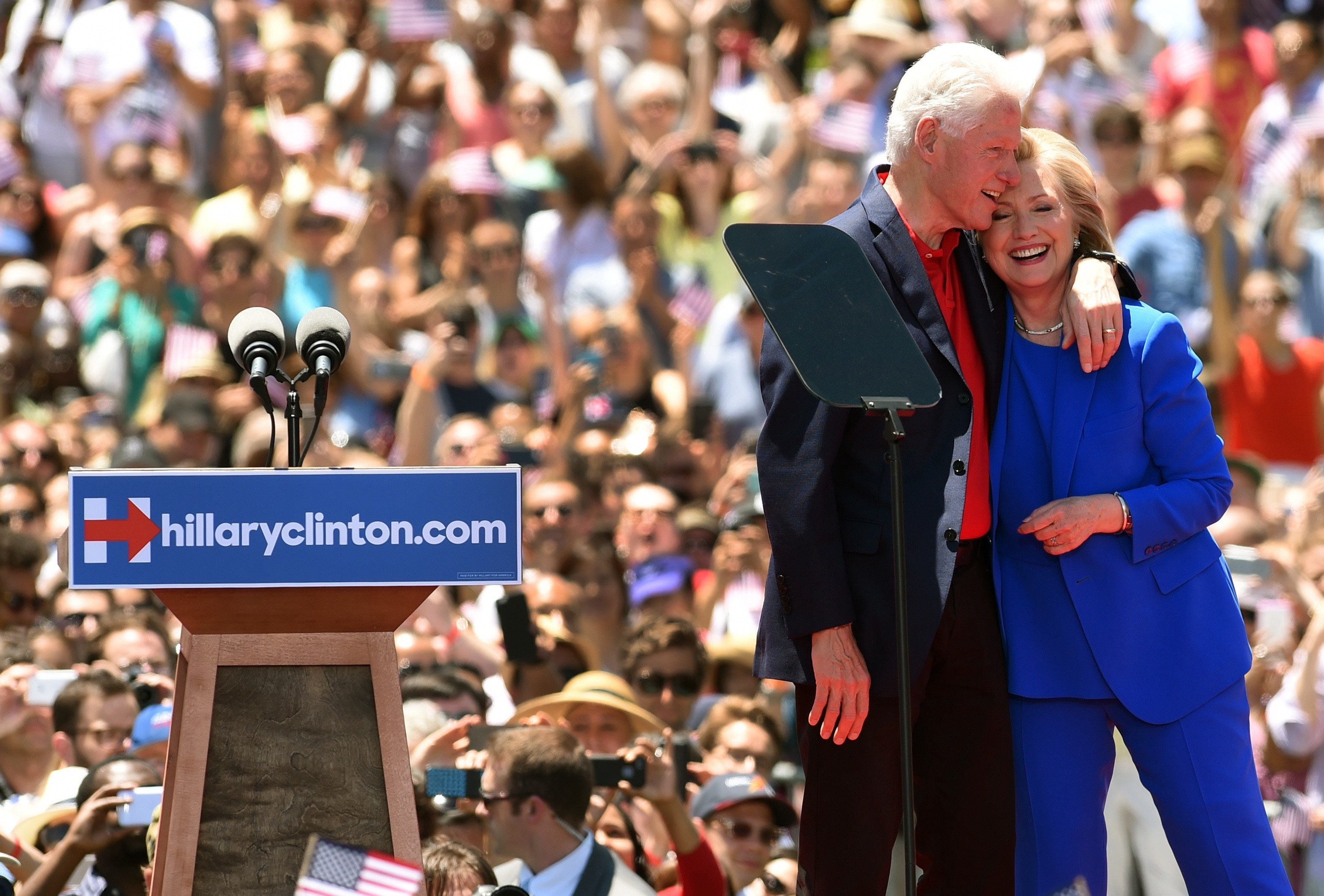 Former Secretary of State Hillary Clinton and Former US President Bill Clinton hug after she officially launched her campaign for the Democratic presidential nomination during a speech at the Franklin D. Roosevelt Four Freedoms Park in New York on June 13, 2015.