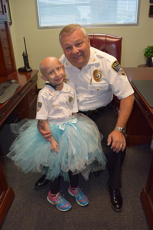 Sydney Coari poses with St. Charles County Police Chief David Todd