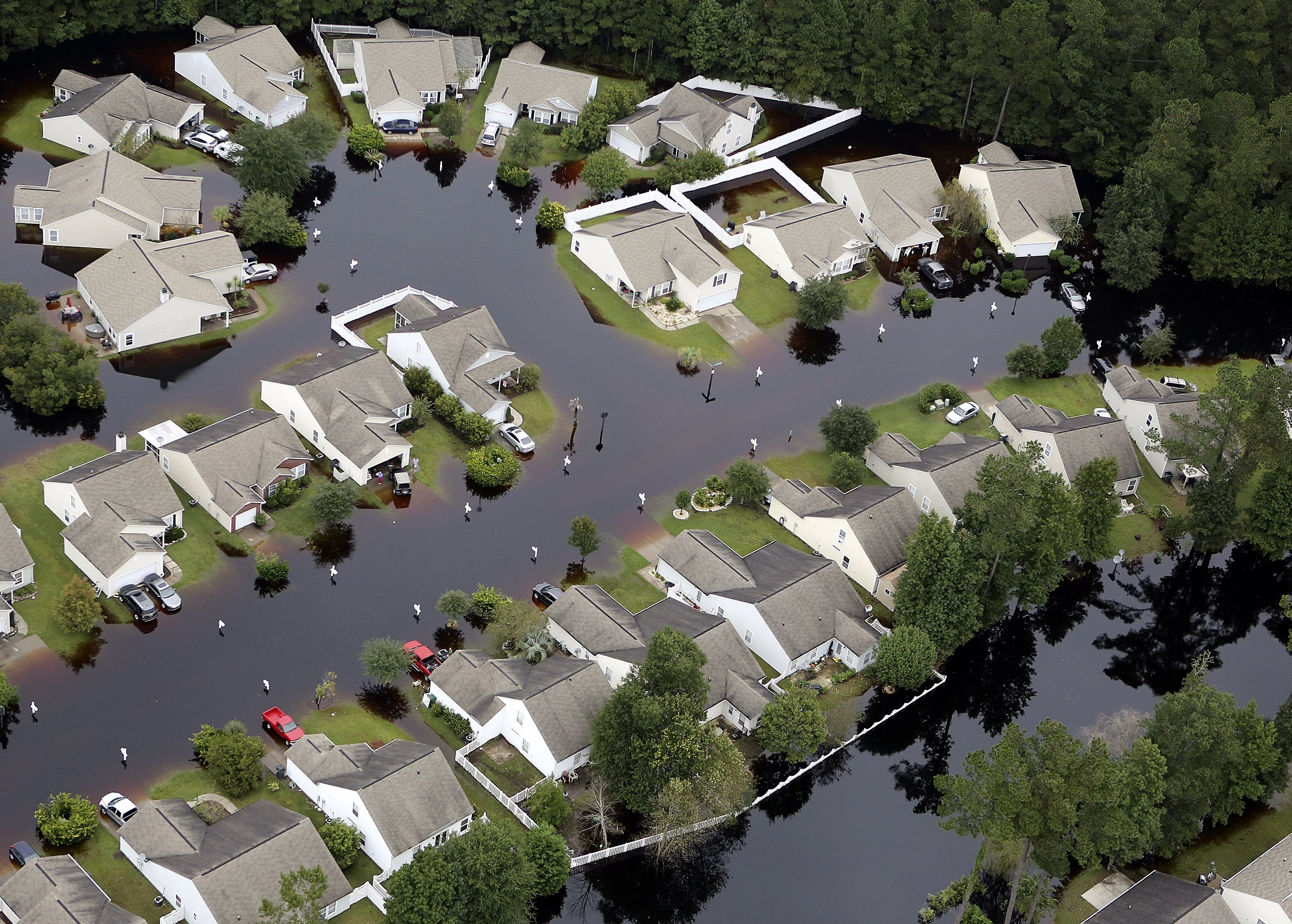 Flooding around homes in the Carolina Forest community in Horry County, S.C., on Oct. 6, 2015.