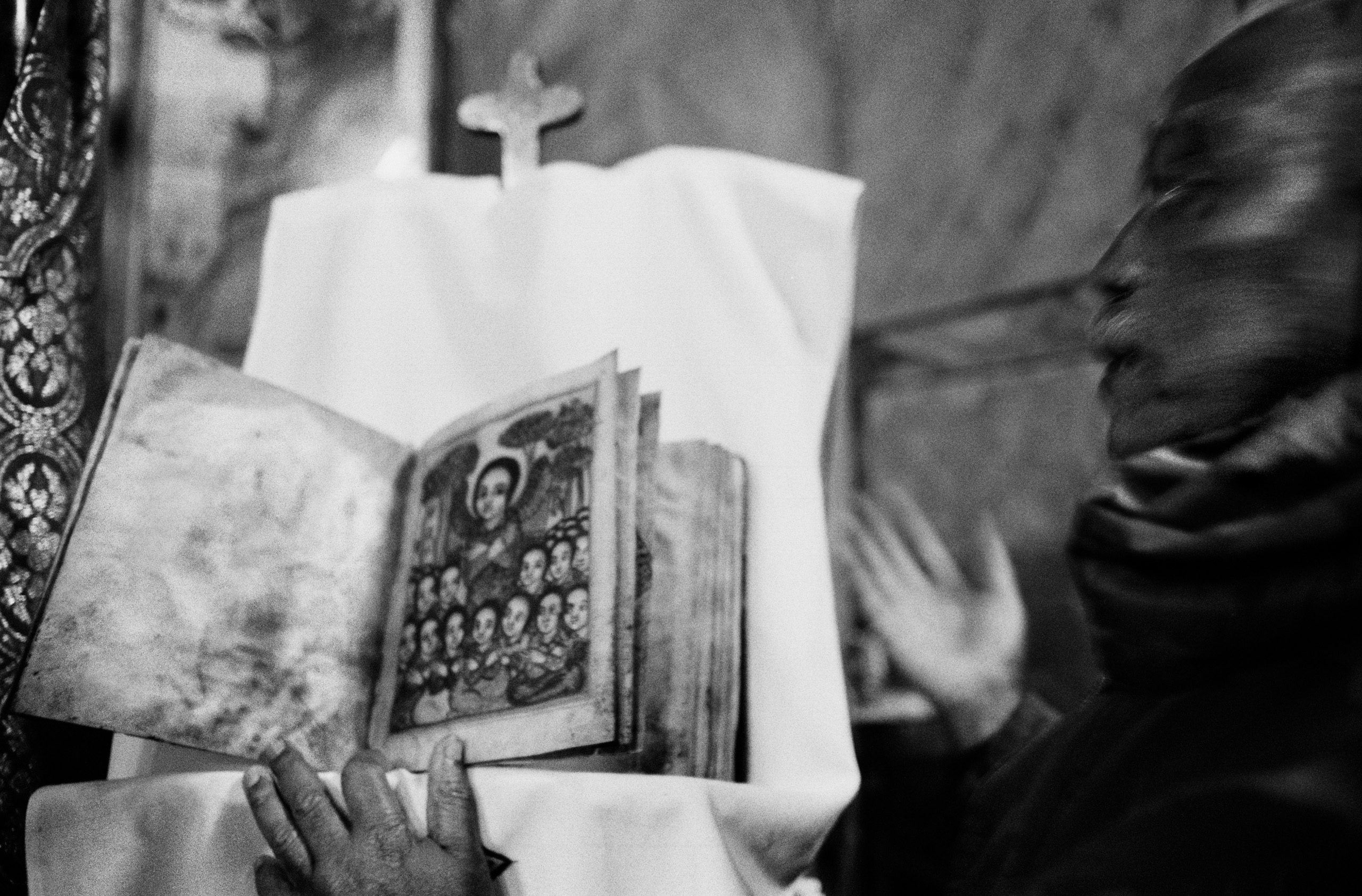 Jerusalem. The guardian of an Ethiopian church showing an ancient copy of the Bible. The Christian community includes Catholics, Orthodox Christians, Egyptian and Ethiopian Coptics between Damascus gate and Jaffa gate. December 2012.