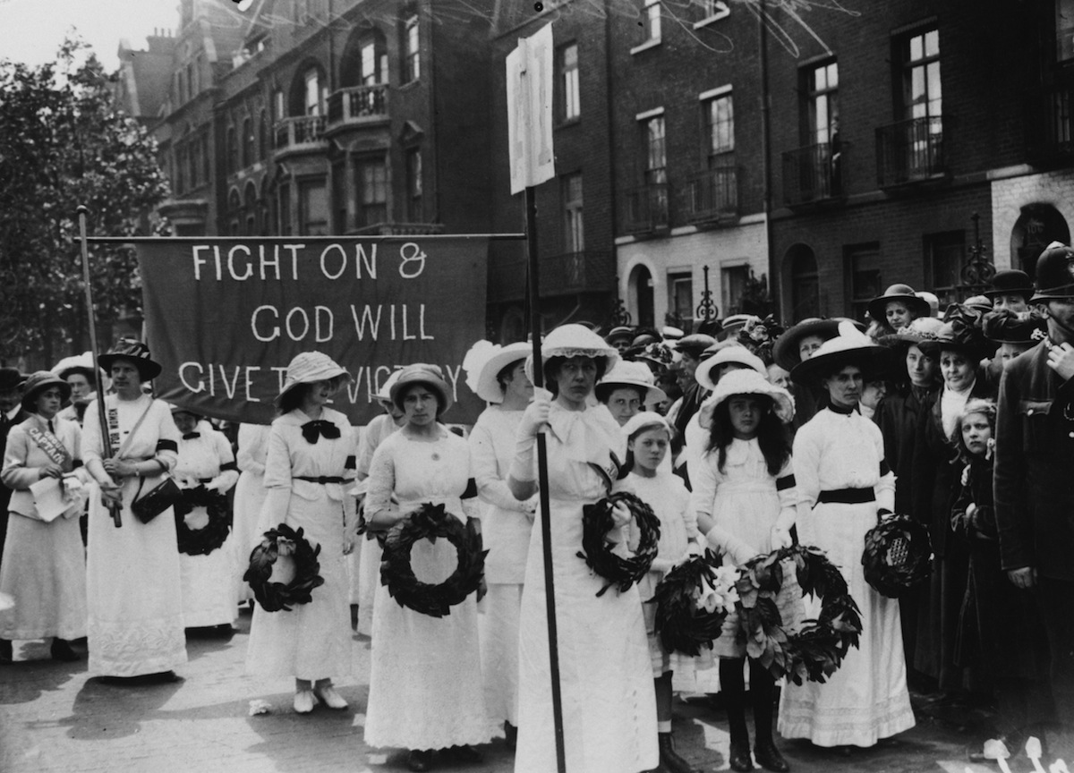 Suffragettes, wearing black armbands, in the funeral procession of English suffragette Emily Davison in London on June 14, 1913.
