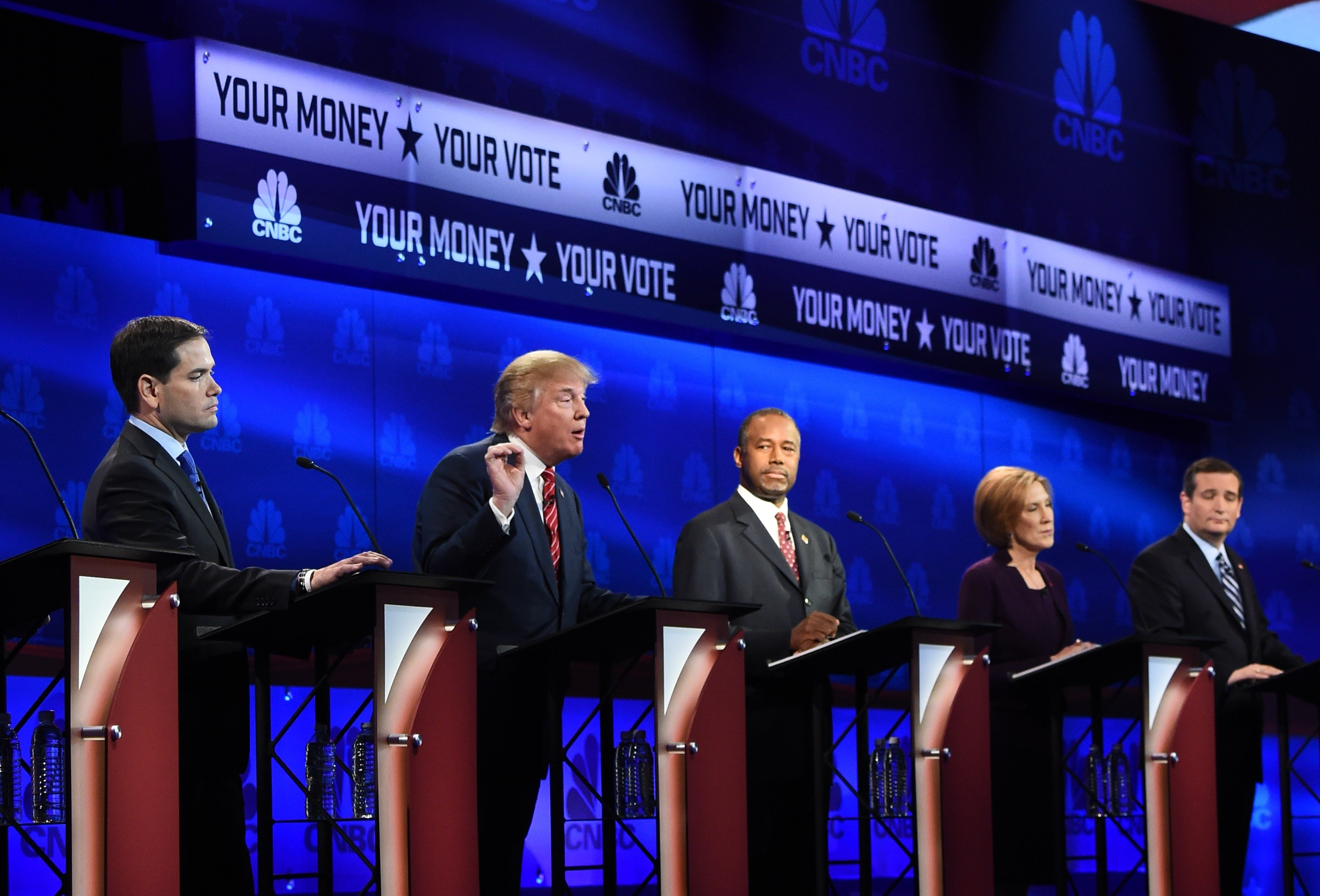 Republican Presidential hopeful Donald Trump (2L) speaks as Marco Rubio (L), Ben Carson (C), Carly Fiorina (2R), and Ted Cruz look on during the CNBC Republican Presidential Debate on Oct. 28, 2015 at the Coors Event Center at the University of Colorado in Boulder, Colo.