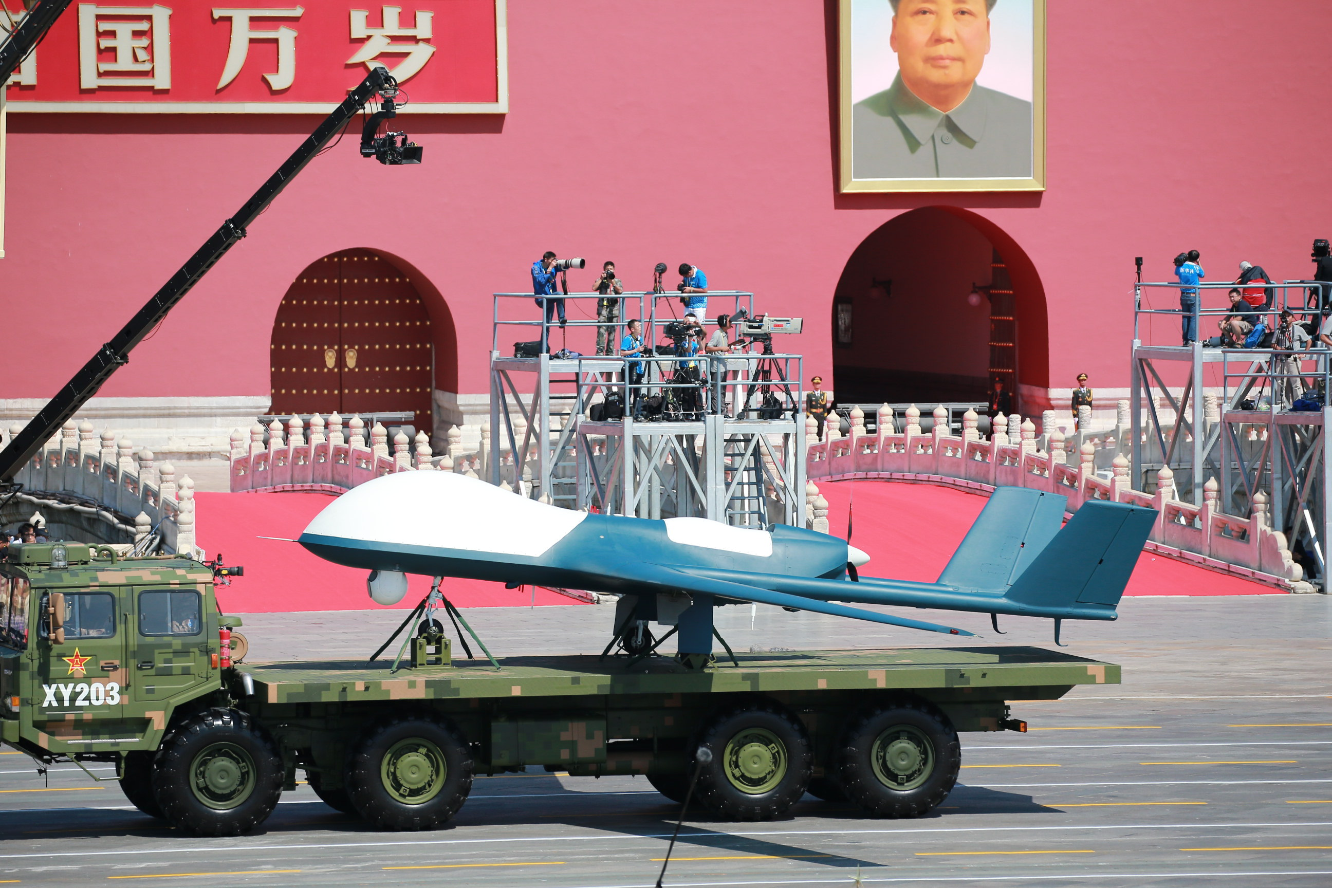 A military vehicle carrying a Wing Loong drone marches past the Tiananmen Rostrum in Beijing, China on Sept. 3 2015.