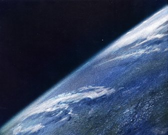 A colorized version of the first photo of the Earth taken from space