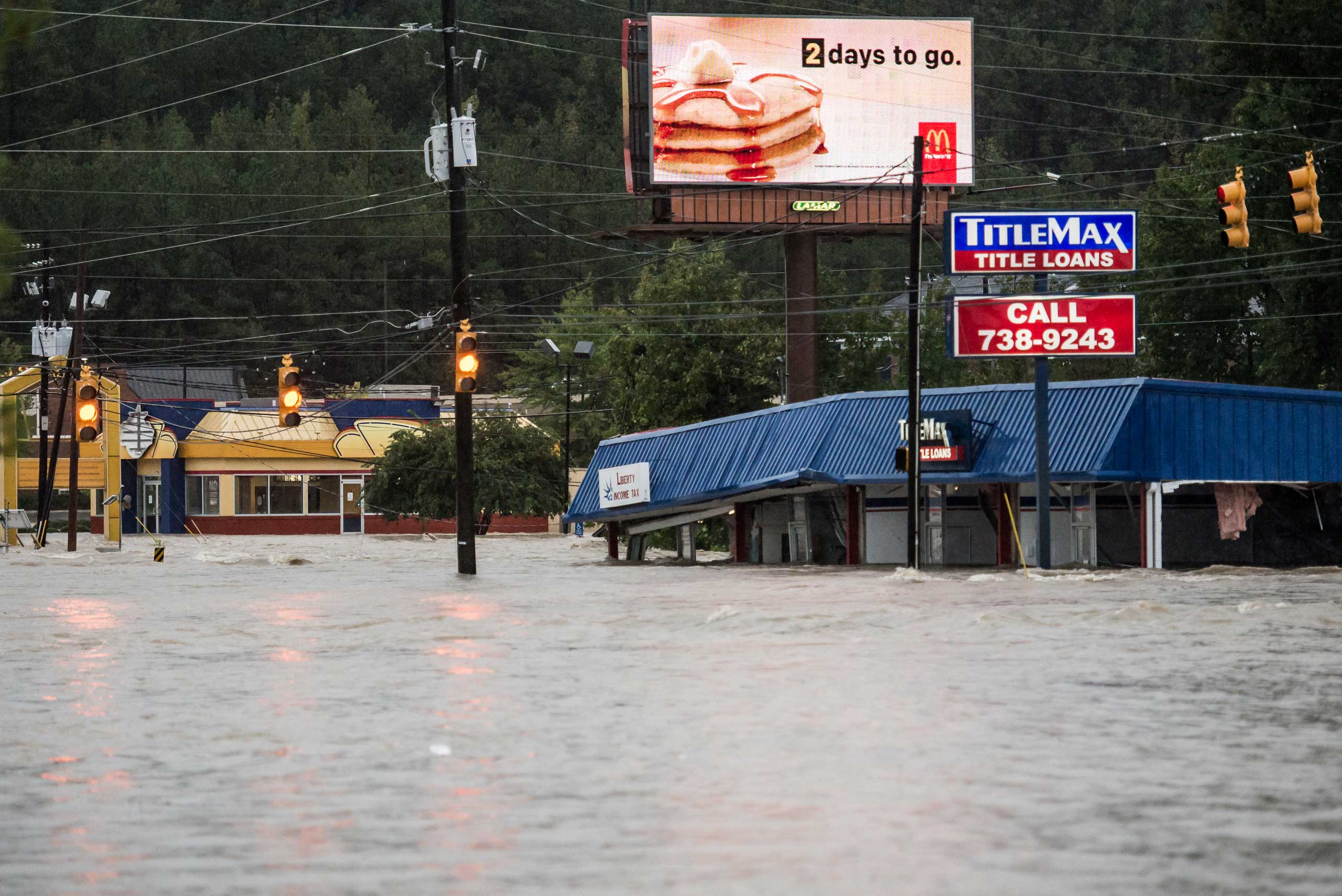 Flood waters rise around a title loan store on Garners Ferry Road in Columbia, S.C., Oct. 4, 2015.