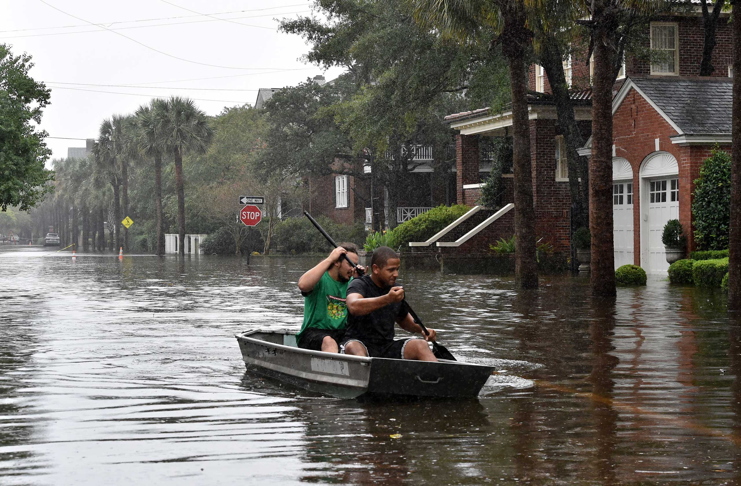 Two man row a boat on a flooded street in Charleston, S.C., on Oct. 4, 2015.
